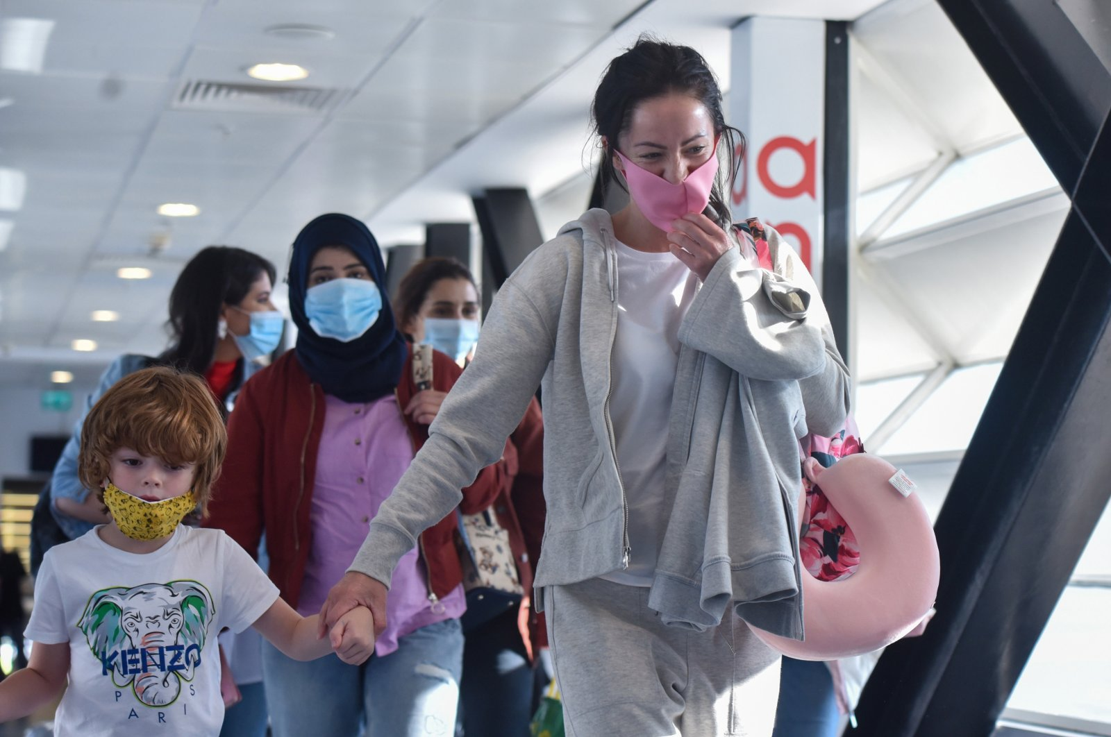 This file photo shows people arriving at an airport in the southern province of Antalya, Turkey. (DHA Photo)