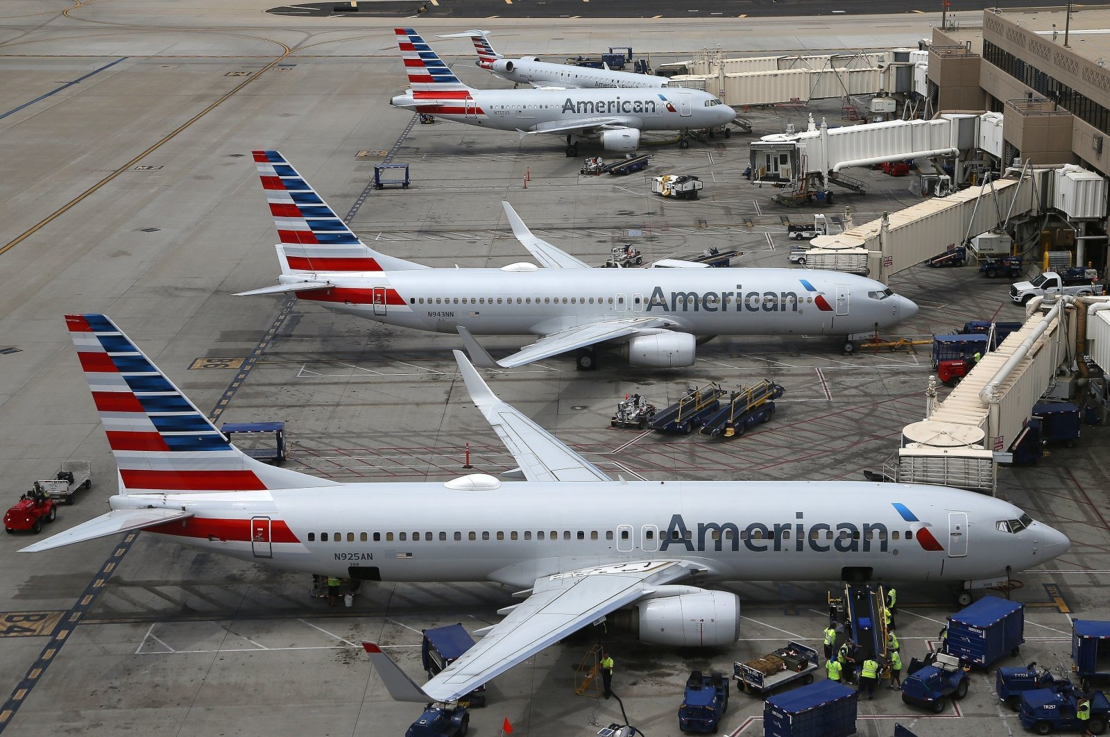 American Airlines planes are parked on the tarmac at Phoenix Sky Harbor International Airport, Phoenix, U.S., July 17, 2019. (AP Photo)