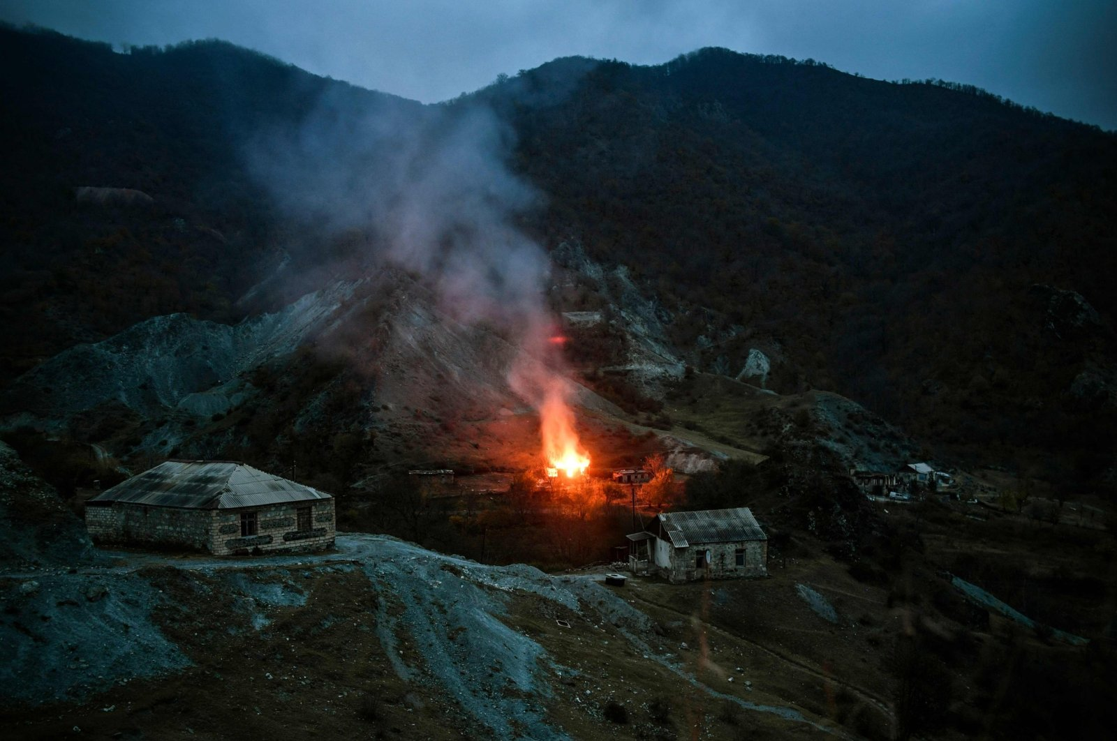 A house burns in a village outside the town of Kalbajar, following the signing of a peace agreement to end the military conflict between Armenia and Azerbaijan over the Nagorno-Karabakh region, Nov. 14, 2020. (AFP Photo)