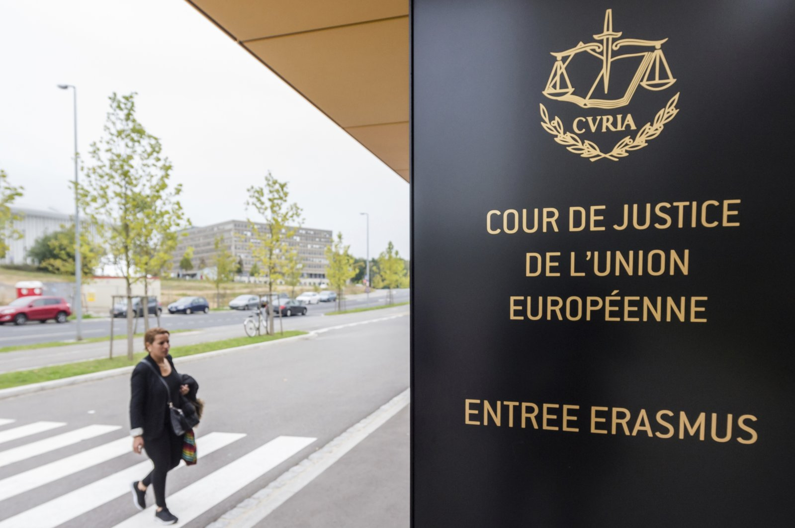 A woman walks by the entrance to the European Court of Justice in Luxembourg, Monday, Oct. 5, 2015. (AP File Photo)