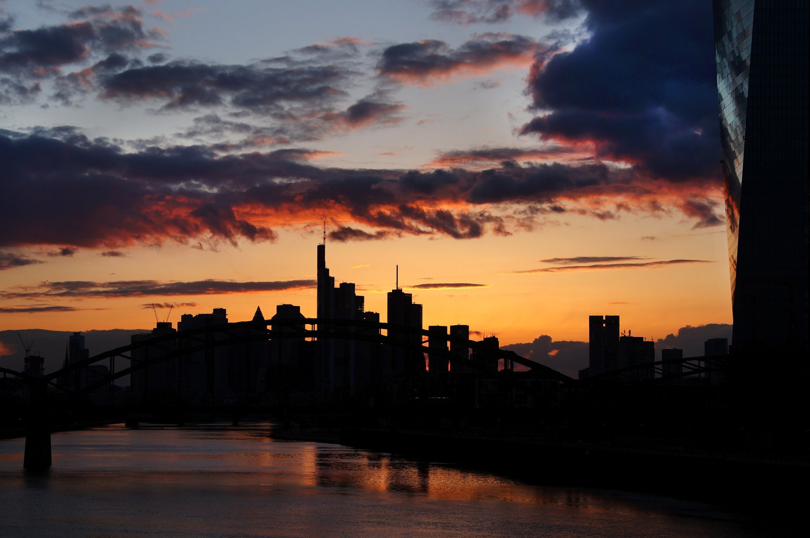 The European Central Bank (ECB) and the skyline with its financial district are seen during sunset as the spread of the coronavirus disease (COVID-19) continues in Frankfurt, Germany, April 13, 2021. (Reuters Photo)