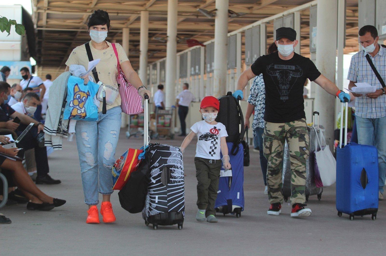 Ukrainian tourists arrive at Antalya airport, southern Turkey, April 19, 2021. (IHA Photo)