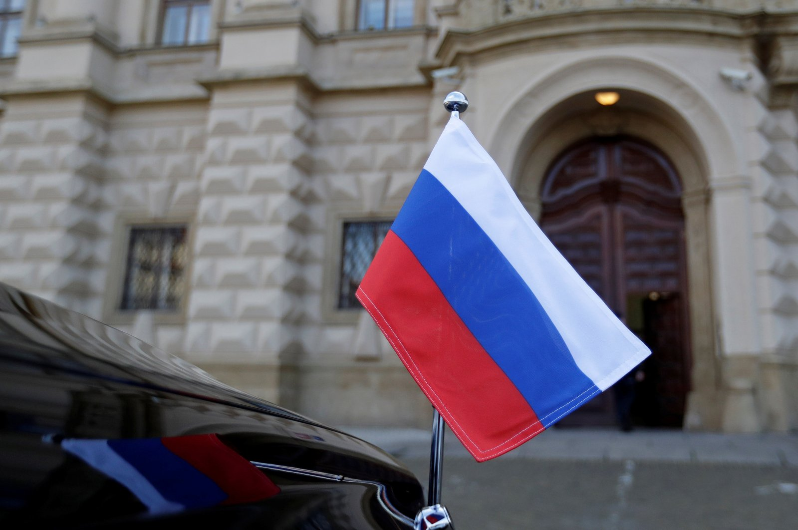 The Russian national flag is seen on a car in front of the Foreign Ministry in Prague, Czech Republic, April 21, 2021. (Reuters Photo)