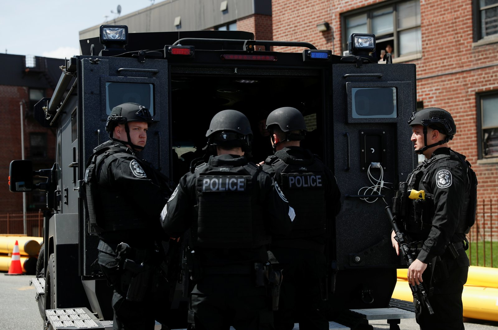 Law enforcement officers stand near a shooting scene in Hempstead, New York, U.S., April 20, 2021. (Reuters File Photo)