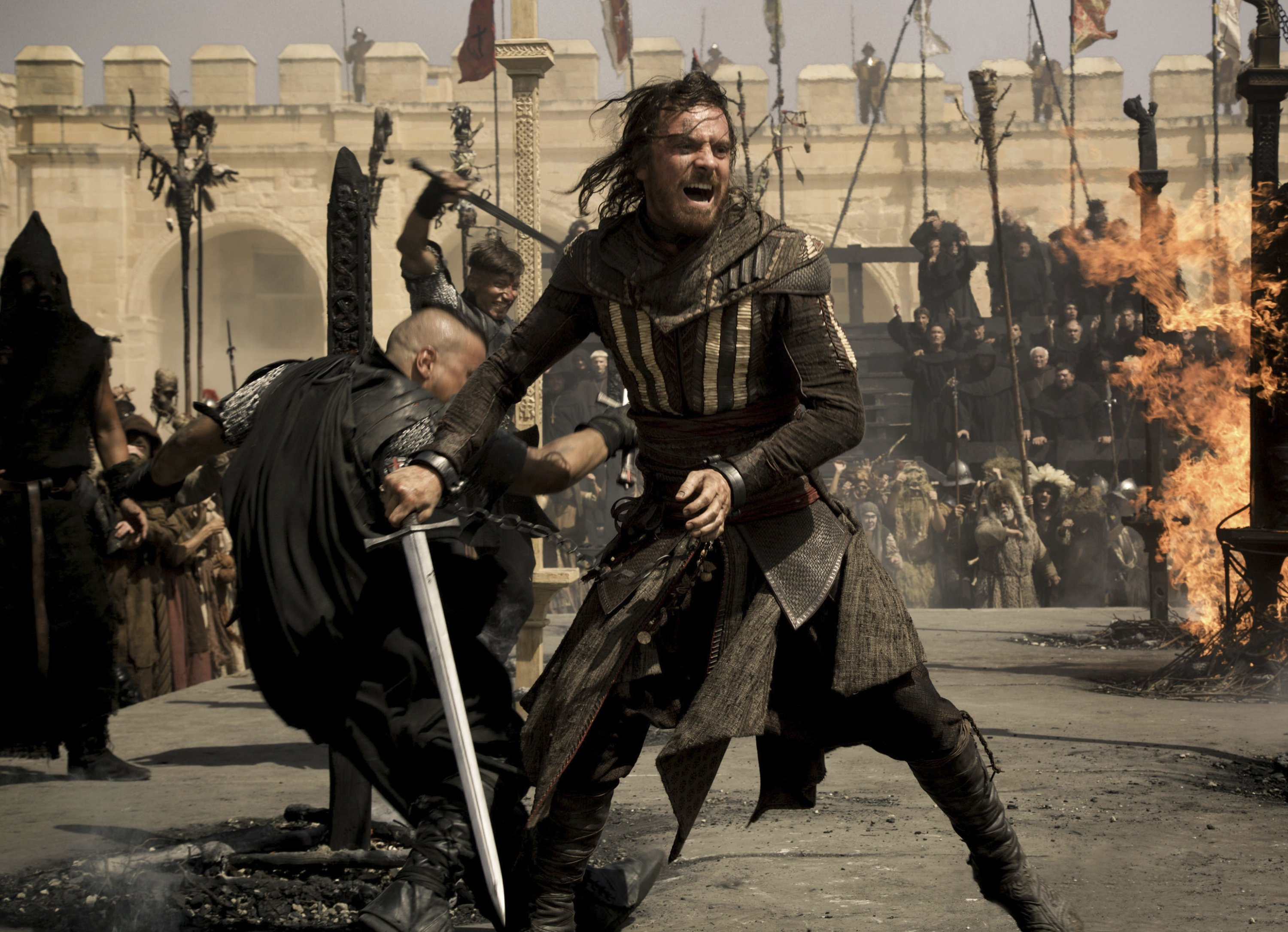 """Actor Michael Fassbender as the character """"Callum Lynch"""", defends himself in a sword fight, in a scene from 'Assassin's Creed,' a film based on the video game series. (20th Century Fox via AP)"""