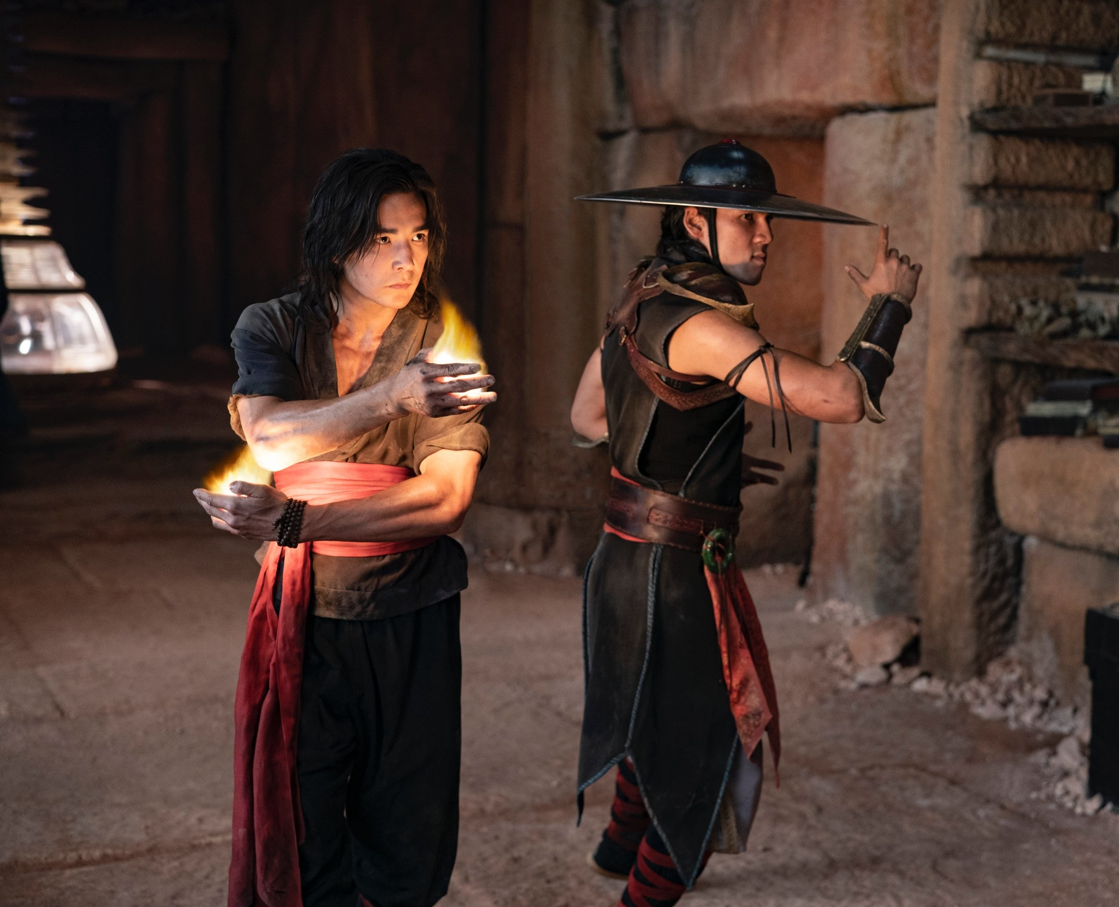 """Ludi Lin (L) playing """"Liu Kang,"""" and Max Huang portraying """"Kung Lao"""" stand back-to-back in a scene from 'Mortal Kombat.' (Warner Bros. Pictures via AP)"""