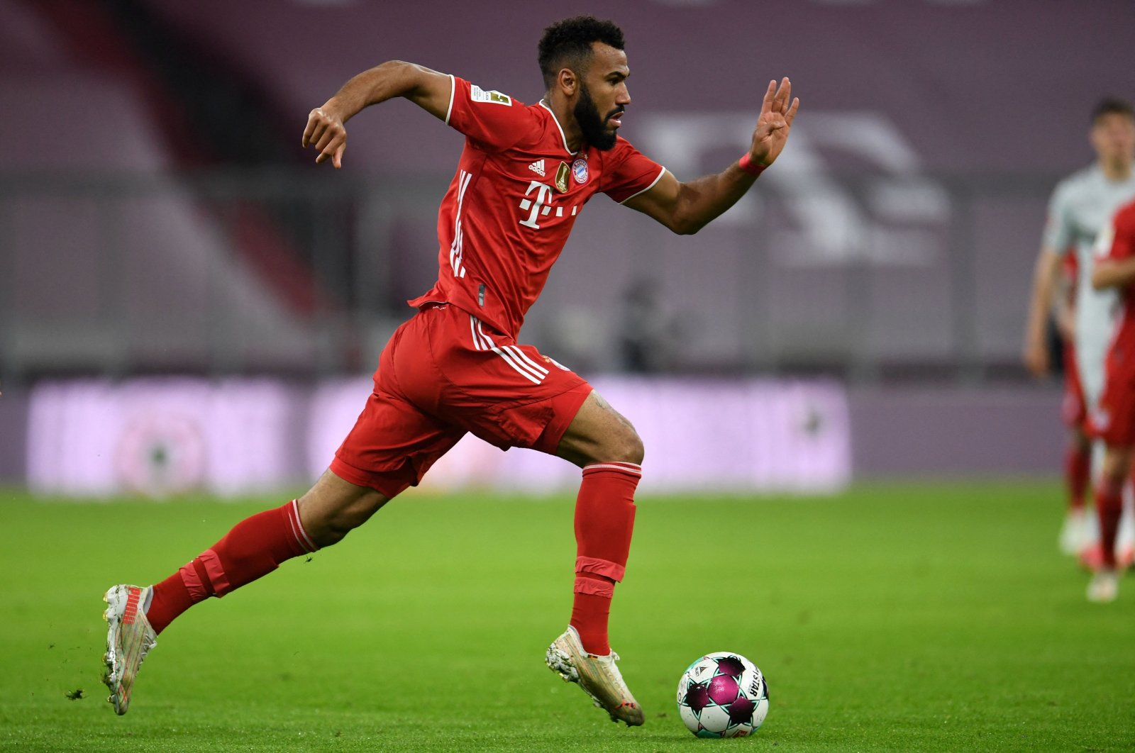 Bayern Munich's Eric Maxim Choupo-Moting runs with the ball during a Bundesliga match against Bayer Leverkusen at the Allianz Arena, in Munich, Germany, April 20, 2021. (AFP Photo)