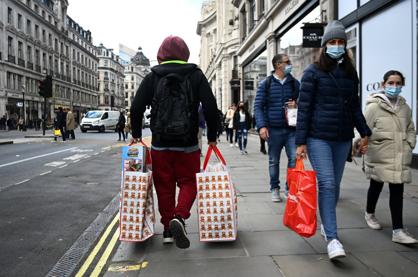 Shoppers walk on Regent Street after the shops reopened in London, Britain, April 12, 2021. (EPA Photo)