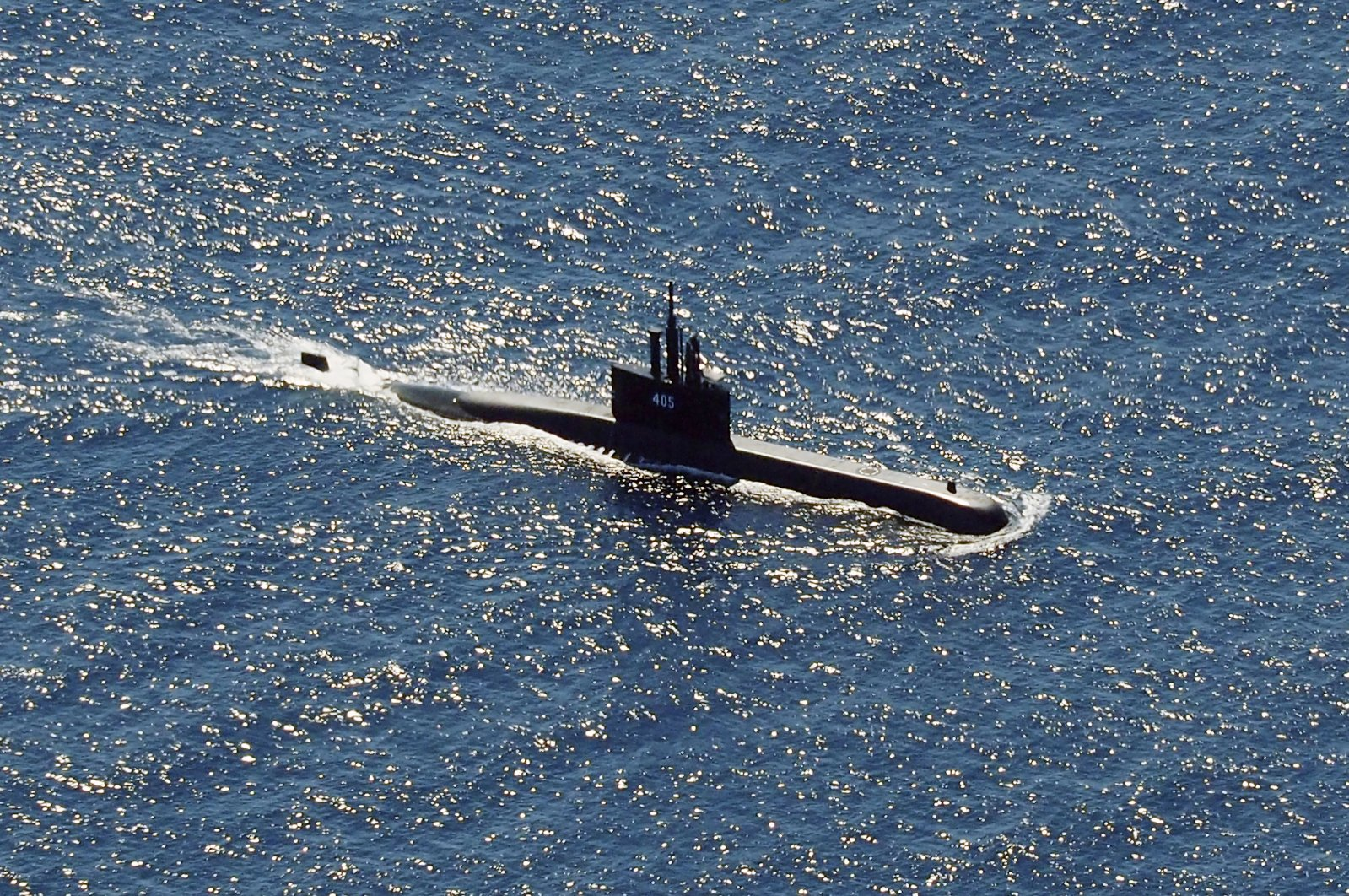 The Indonesian Navy submarine KRI Alugoro sails during a search for KRI Nanggala, another submarine that went missing while participating in a training exercise on Wednesday, in the waters off Bali Island, Indonesia, April 22, 2021. (AP Photo)