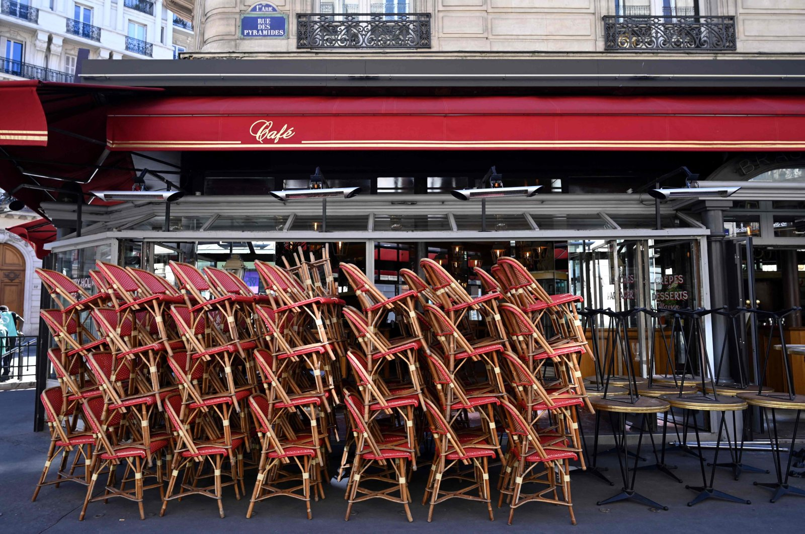 Chairs are piled on a terrace of a closed restaurant as the government eases lockdown measures taken to curb the spread of the COVID-19 pandemic, Paris, France, March 15, 2021. (AFP Photo)