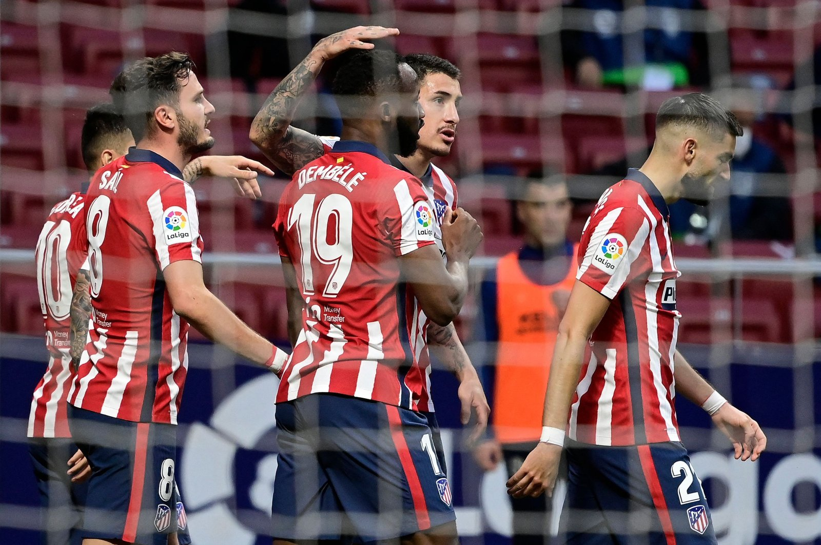 Atletico Madrid players celebrate a goal during the La Liga against Huesca at the Wanda Metropolitano stadium in Madrid, Spain, April 22, 2021. (AFP Photo)