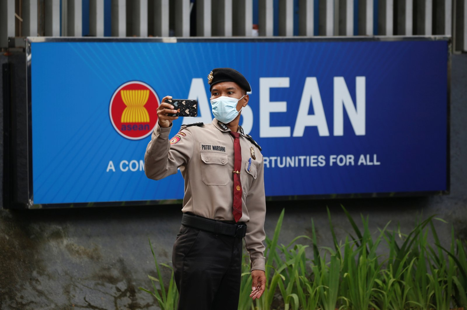 A police officer takes a picture outside the Association of Southeast Asian Nations (ASEAN) secretariat building, ahead of the ASEAN leaders' meeting in Jakarta, Indonesia, April 23, 2021. (Reuters Photo)