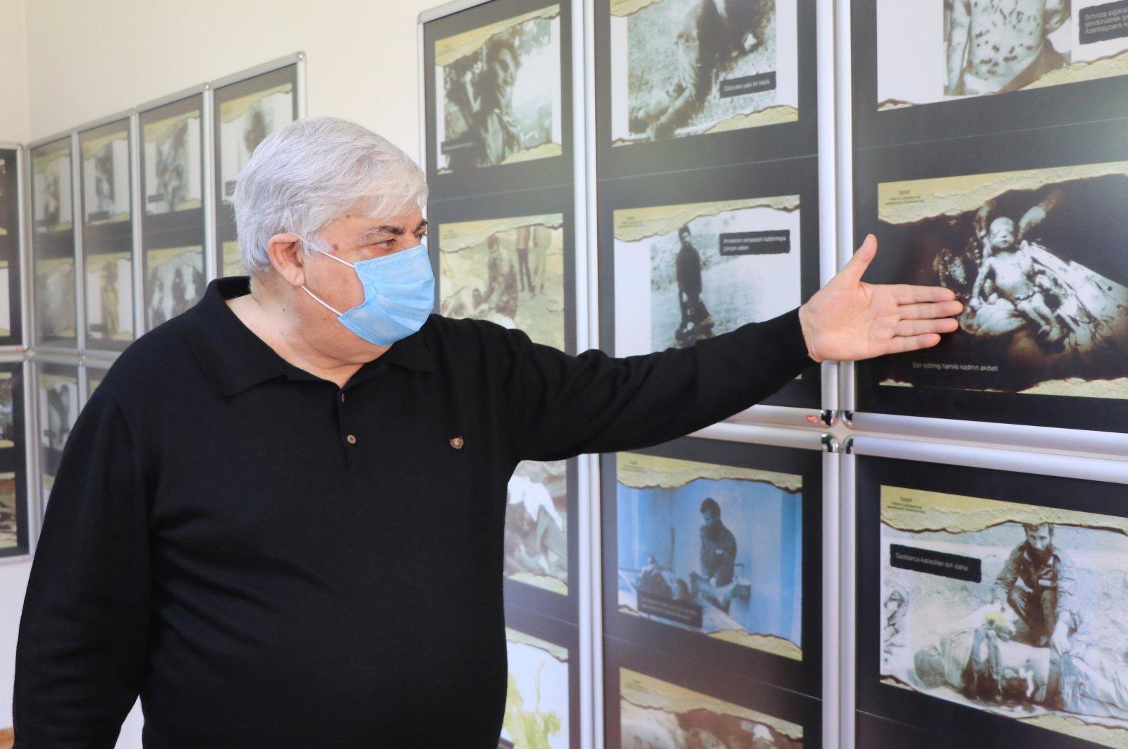 Bilal Dündar, Turkey-Azerbaijan Associations Federation Chair, shows pictures of victims killed by Armenian groups during World War I, in northwestern Turkey's Kocaeli province, April 23, 2021. (AA Photo)