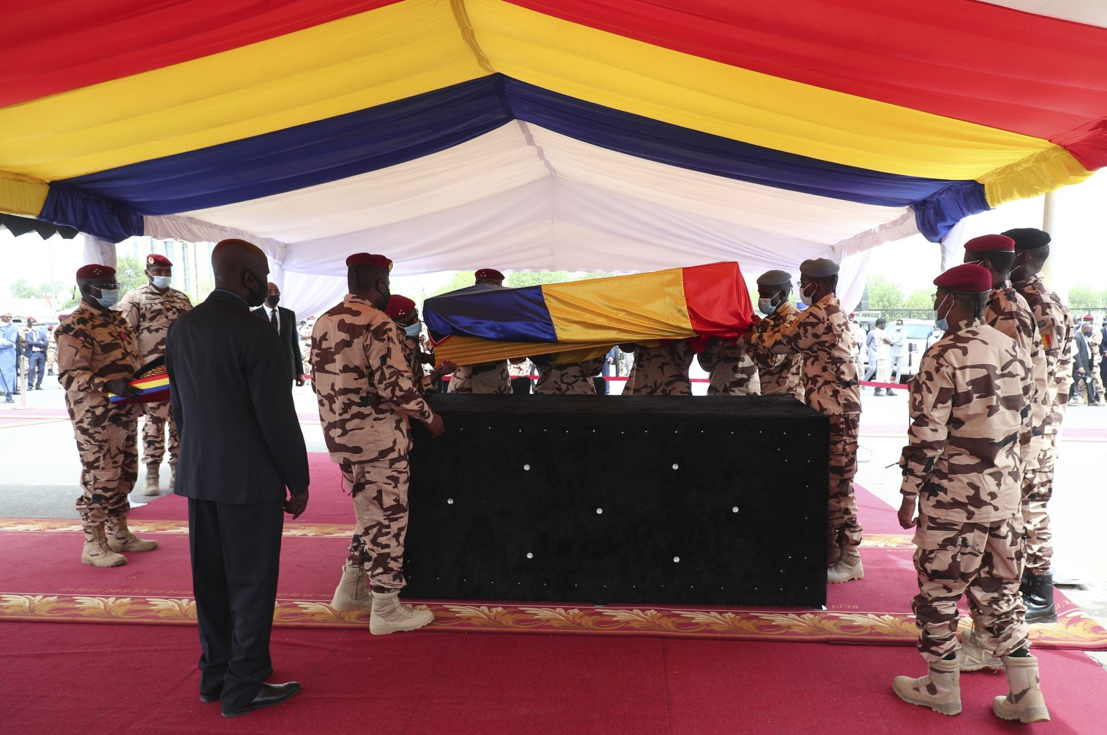 Chadian soldiers carry the coffin of late Chadian President Idriss Deby Itno during the state funeral in N'Djamena, Chad, April 23, 2021. (AP Photo)