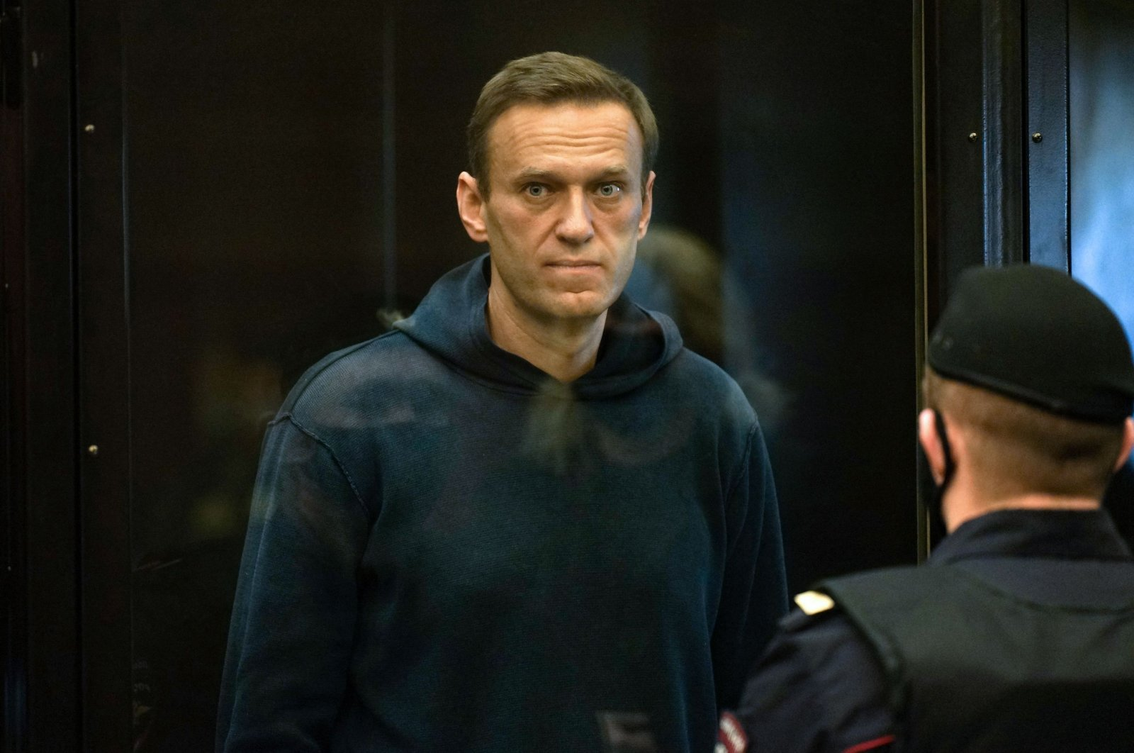 Russian opposition leader Alexei Navalny, charged with violating the terms of a 2014 suspended sentence for embezzlement, stands inside a glass cell during a court hearing in Moscow, Russia, Feb. 2, 2021. (AP)