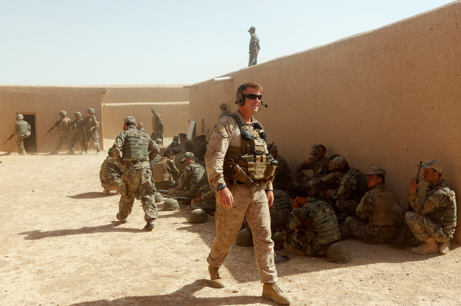 A U.S. Marine (C) walks as Afghan National Army (ANA) soldiers attend a training exercise in Helmand province, Afghanistan, July 5, 2017. (Reuters Photo)