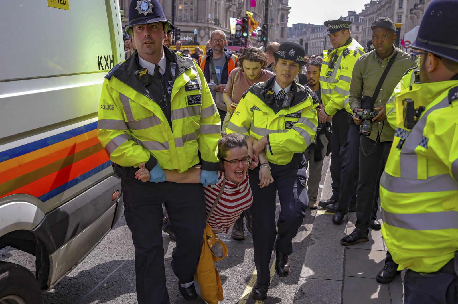 Police arrest protesters as they block traffic on Oxford Circus, London, U.K, Thursday, April 18, 2019. (AP Photo)