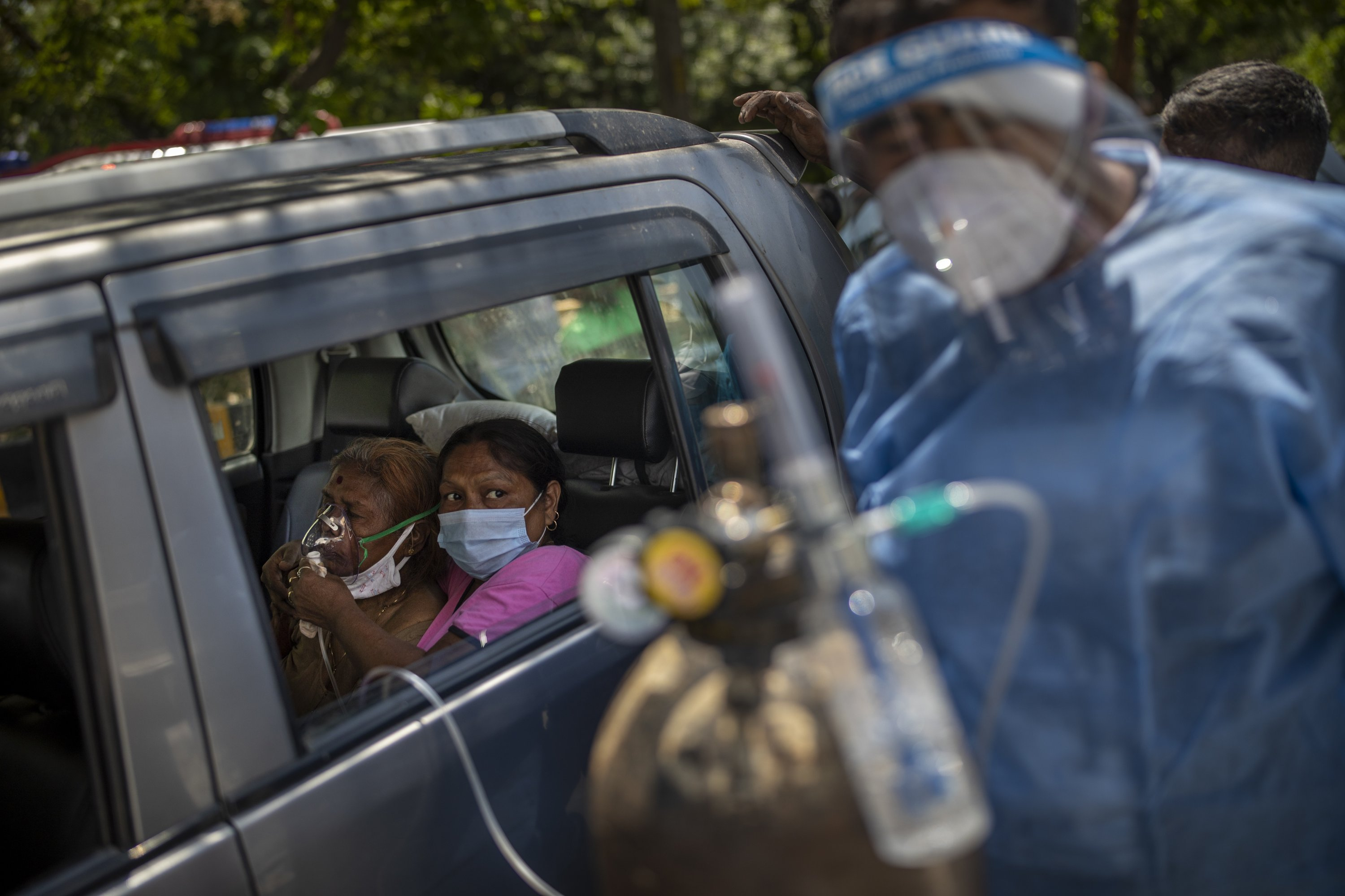 A patient receives oxygen inside a car provided by a Gurdwara, a Sikh place of worship, in New Delhi, India, April 24, 2021. (AP Photo)