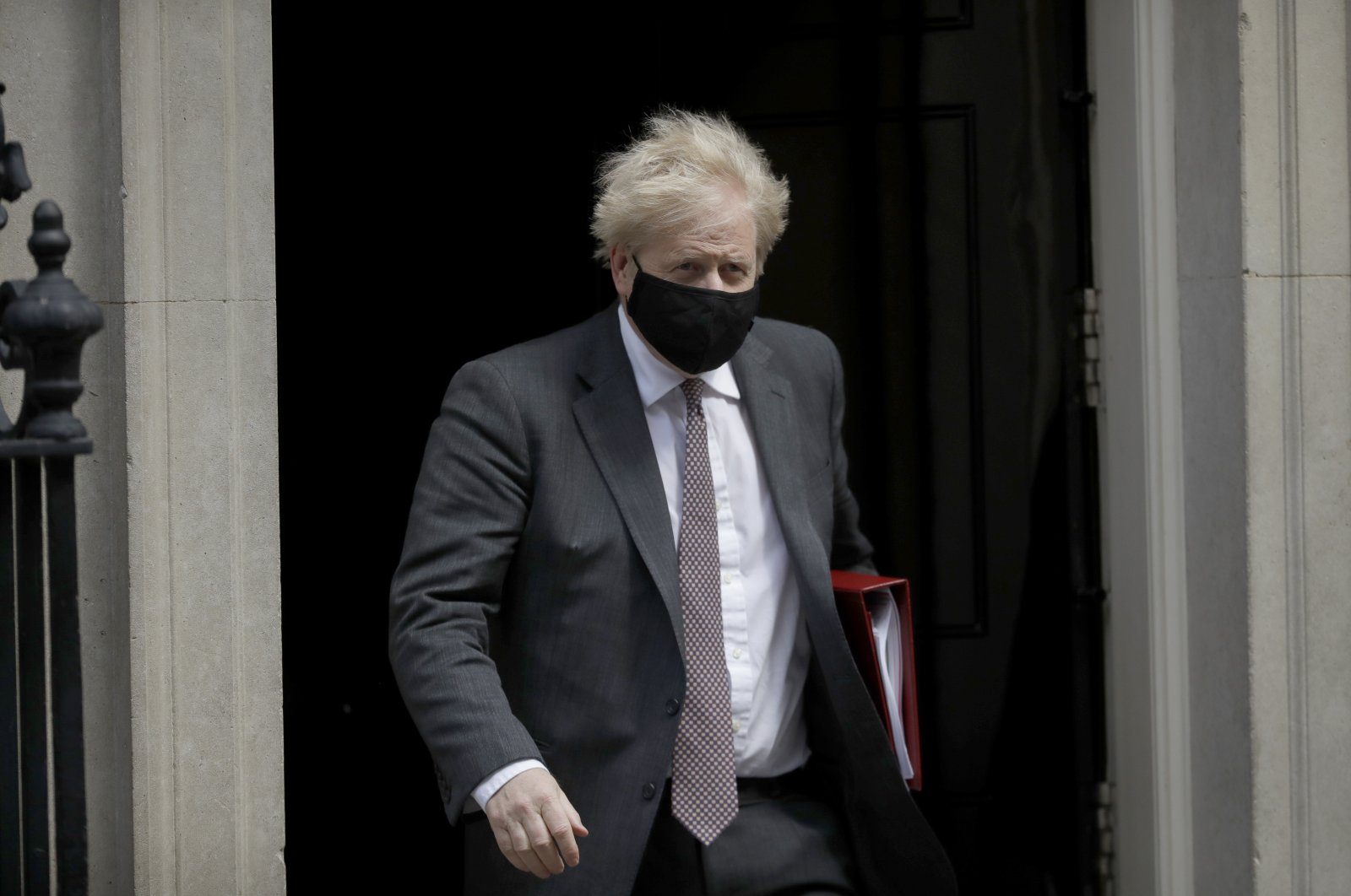 British Prime Minister Boris Johnson leaves to attend the weekly Prime Minister's Questions at the Houses of Parliament from 10 Downing Street, in London, England, April 21, 2021. (AP Photo)