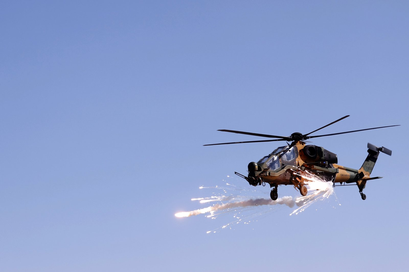 A Turkish military helicopter fires its weapons during a military exercise in Kars province, eastern Turkey, Feb. 12, 2021. (AA Photo)