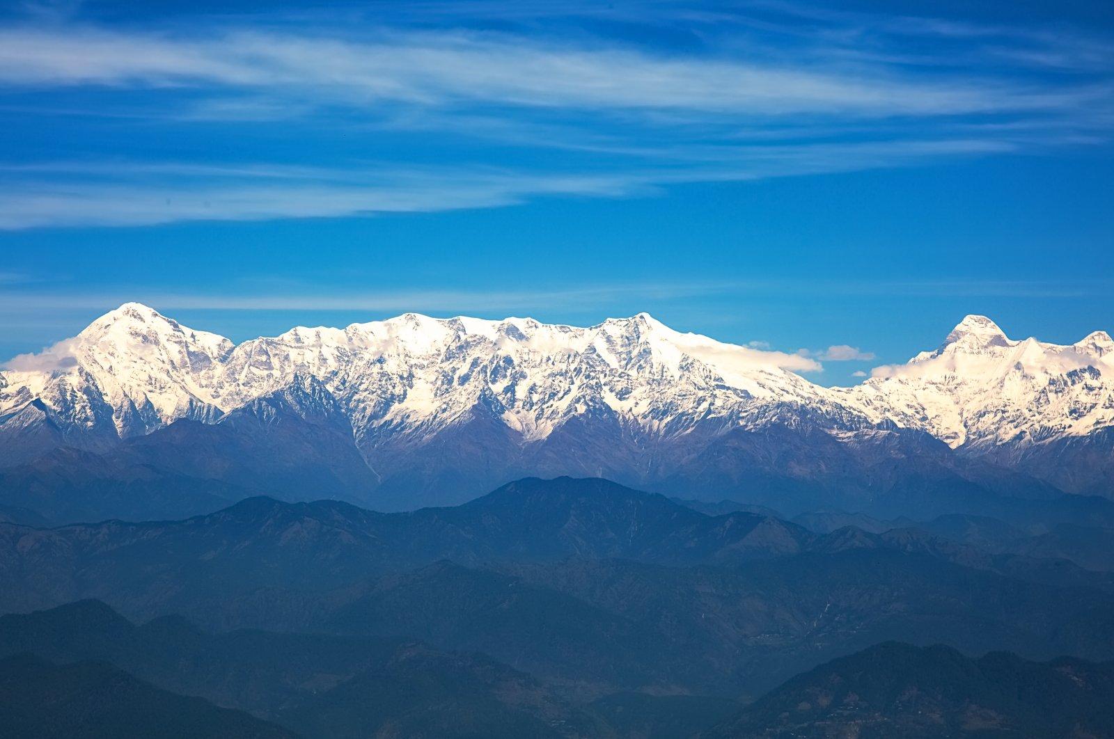 Kumaon Himalayan mountain range with notable peaks like Nandaghunti, Trishul, Nanda Devi as seen from Binsar zero-point Uttarakhand, India. (Shutterstock Photo)