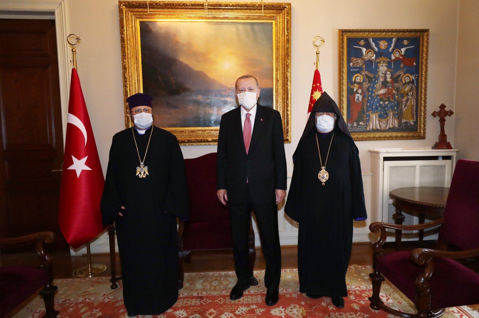 President Recep Tayyip Erdoğan (C) meets with Armenian Patriarch Sahak Maşalyan (L) in Istanbul, Turkey, Oct. 22, 2020. (AA Photo)
