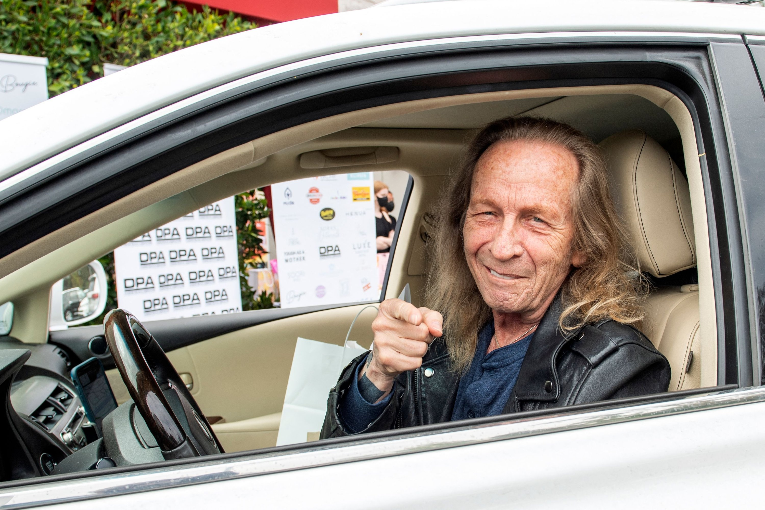 Paul Raci, nominated for an Academy Award for Best Supporting Actor for his role in 'Sound of Metal,' arrives to pick up his gift bags at the drive-through gifting event at the Luxe Hotel in Brentwood, California, U.S., April 24, 2021. (AFP Photo)