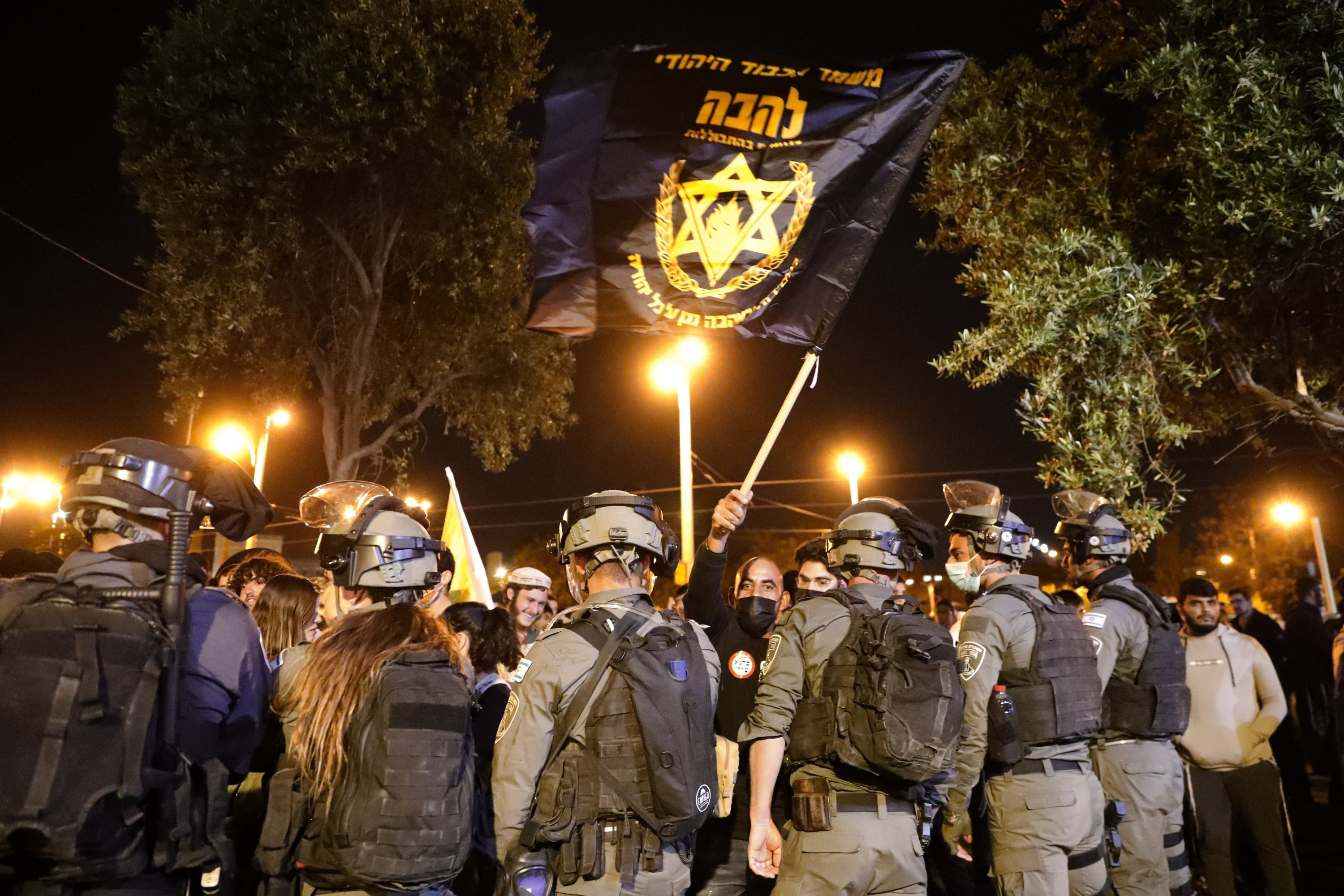 Israeli border police block members of Lahava, a Jewish extremist group, from approaching the Damascus Gate to protest amid heightened tensions in the city, just outside the Old City, East Jerusalem, April 22, 2021. (AP)