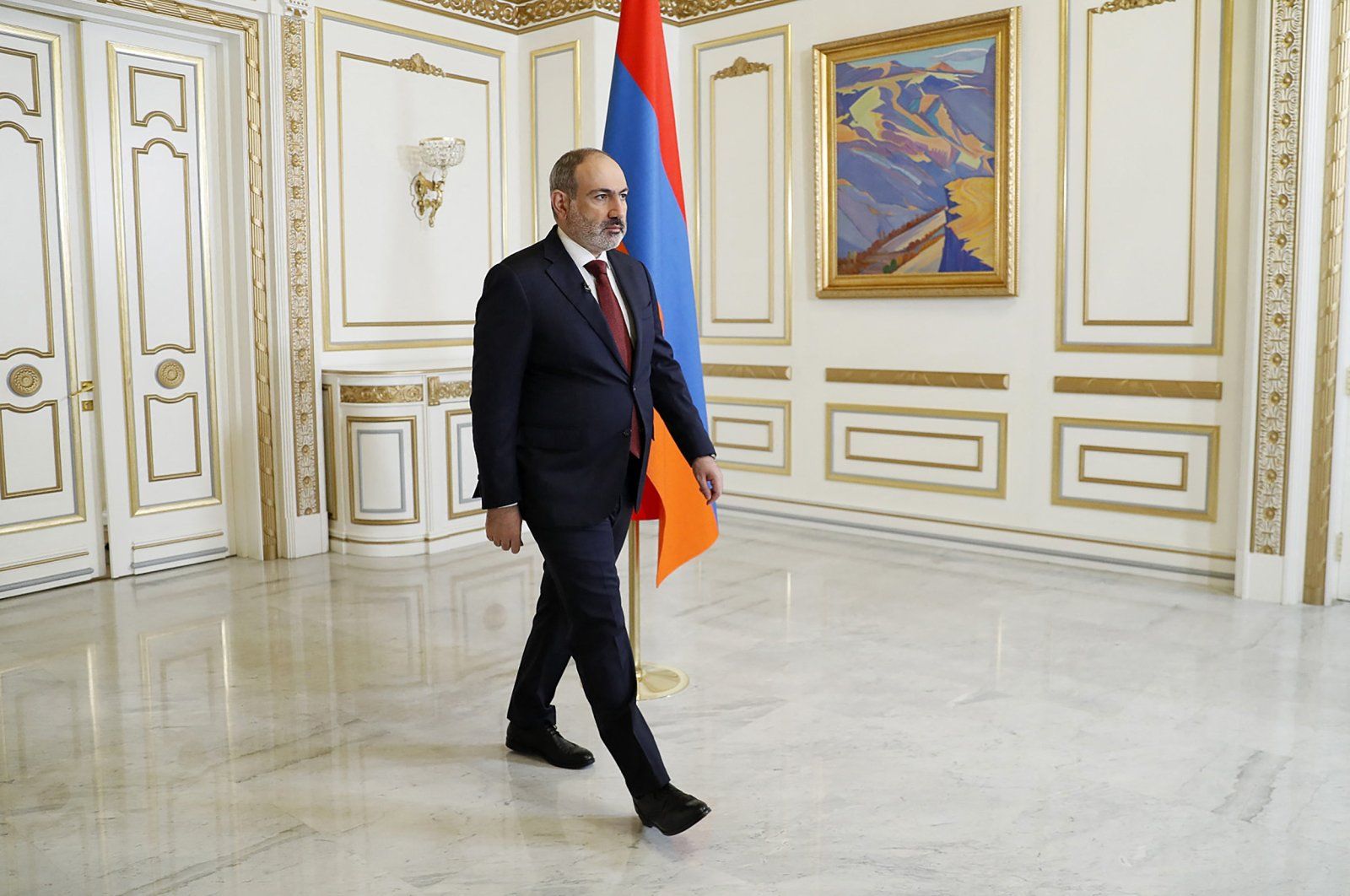 Armenian Prime Minister Nikol Pashinian leaves a hall after addressing the nation in Yerevan, Armenia, Sunday, April 25, 2021. (AFP Photo)
