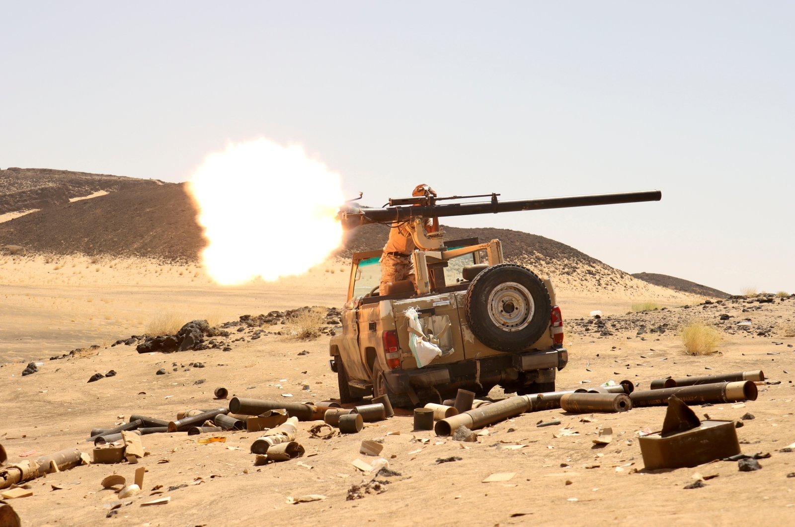 A Yemeni government fighter fires a vehicle-mounted weapon at a front line position during fighting against Houthi fighters in Marib, Yemen, March 9, 2021. (Reuters Photo)