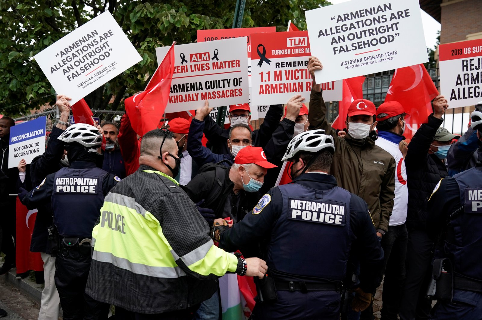 """Supporters of Turkey counter protest members of the Armenian diaspora as they rally in front of the Turkish Embassy after U.S. President Joe Biden recognized the 1915 events as """"genocide"""" in Washington, U.S., April 24, 2021. (Reuters Photo)"""