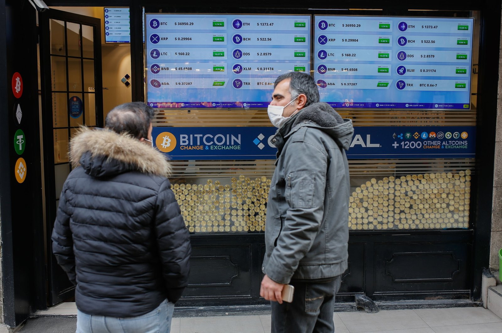 Two men stand in front of a Bitcoin shop in Istanbul, Turkey, Jan. 19, 2021. (Shutterstock Photo)