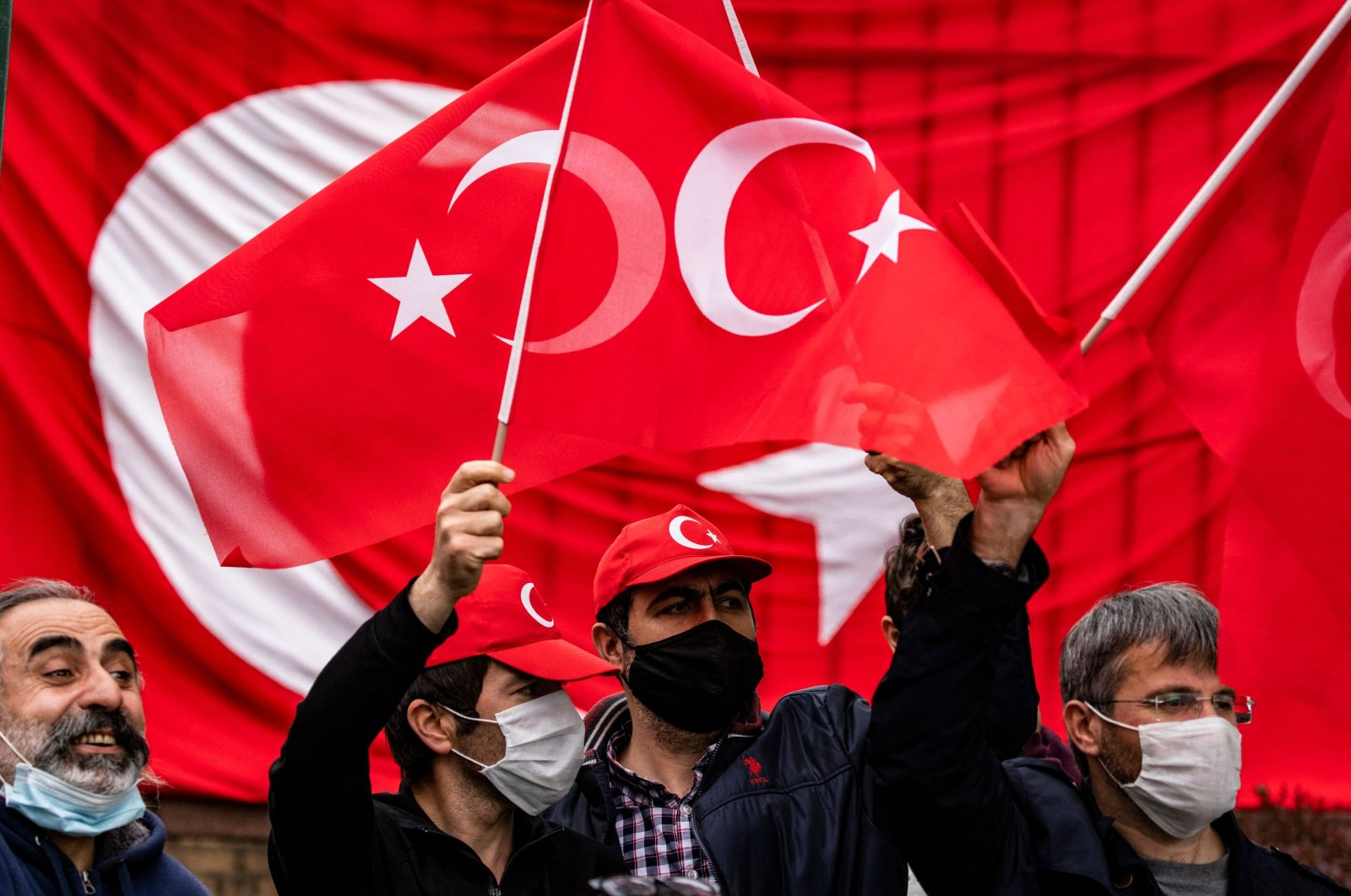 Turkish counter-protestors are kept apart from Armenian protestors to avoid confrontation in front of the Turkish Embassy on the 106th anniversary of the 1915 events in Washington, DC on April 24, 2021. (AFP)