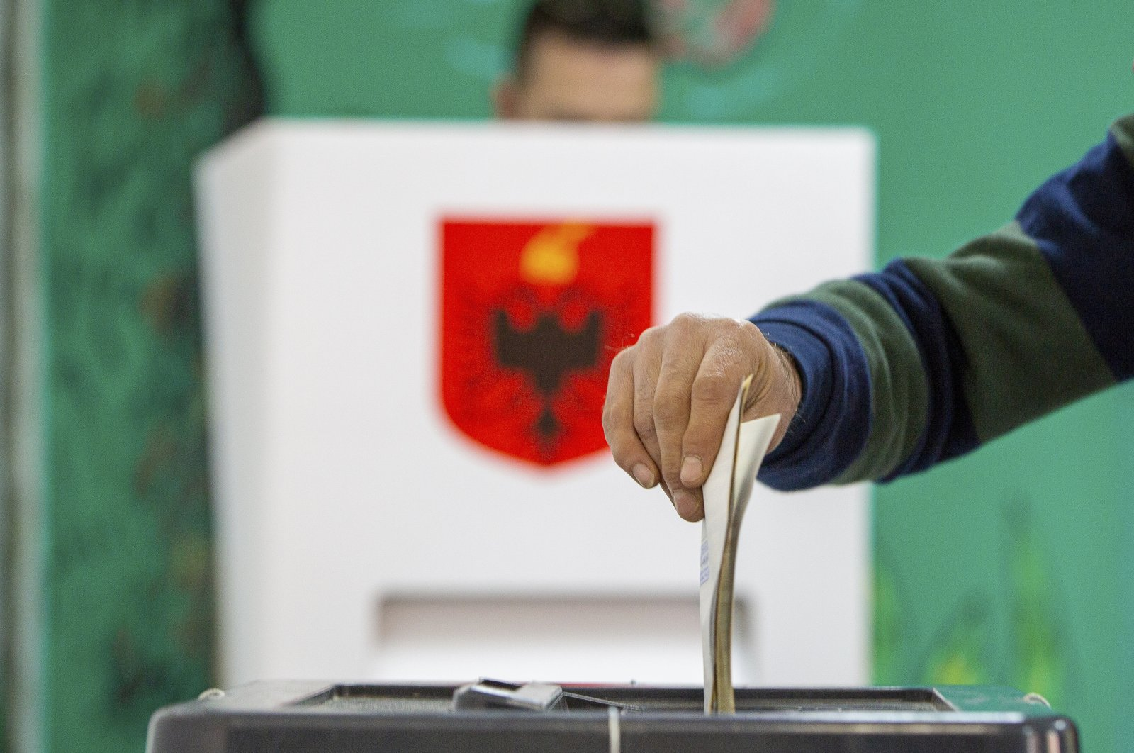 A man casts his vote during parliamentary elections in capital Tirana, Albania, Sunday, April 25, 2021. (AP Photo)