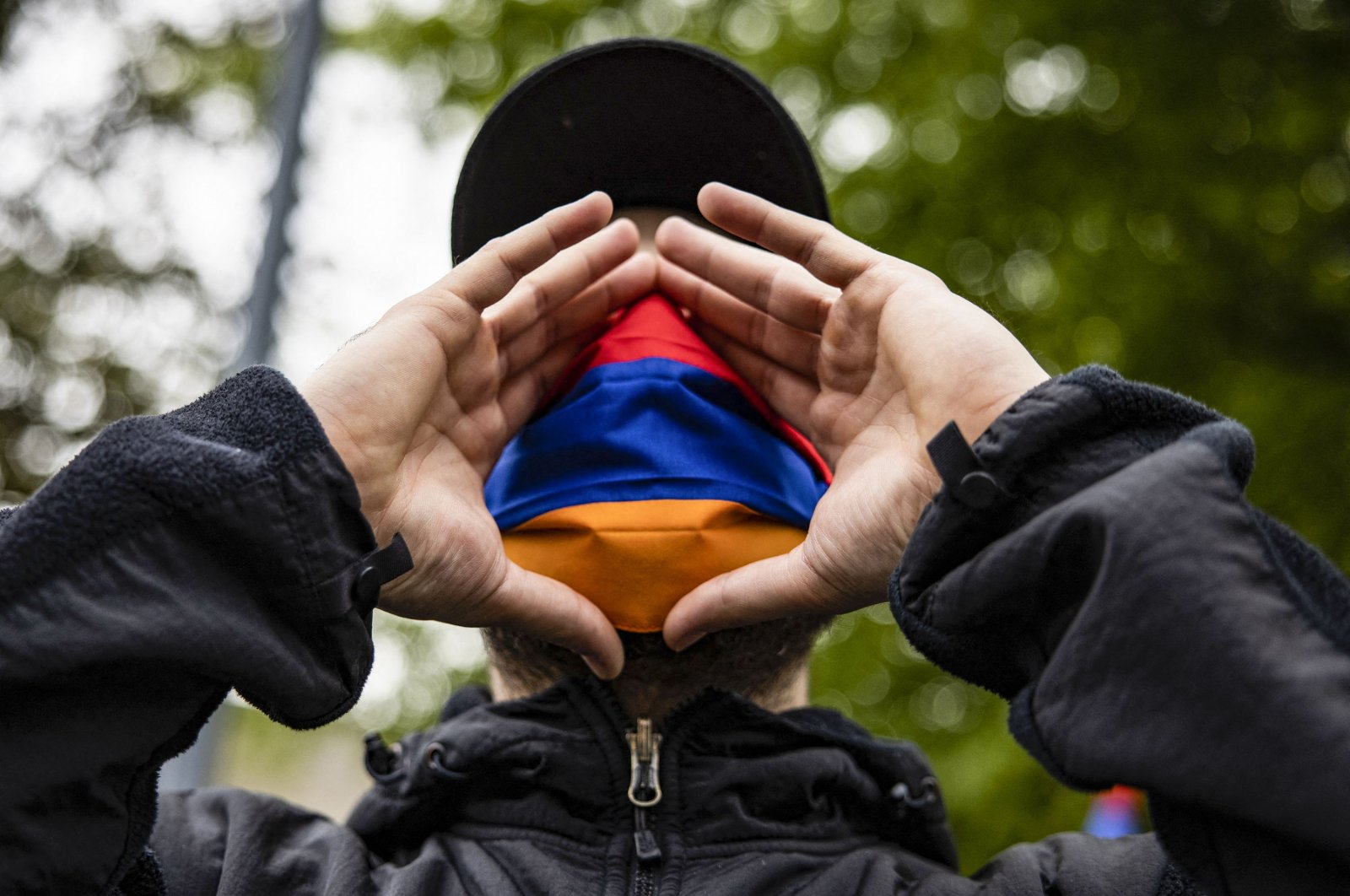Armenians protest outside of the Turkish Embassy on the 106th anniversary of 1915 events in Washington, DC on April 24, 2021. (AFP)