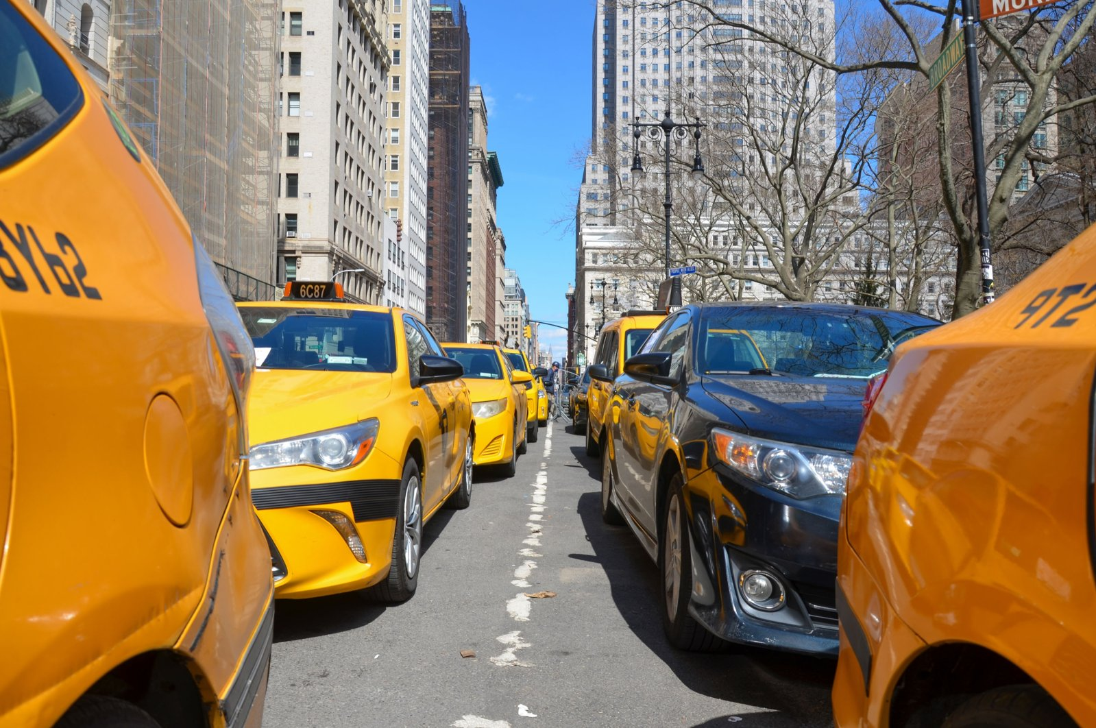 Yellow taxis are lined up near New York City Hall demanding Mayor Bill de Blasio to support the Drivers plan to help the drivers live their lives debt-free, March 27, 2021. (Getty Images)