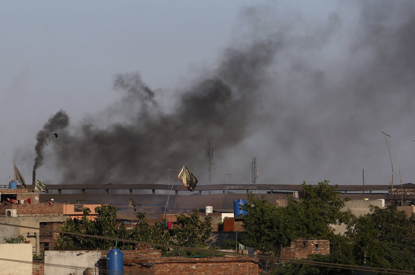 Black smoke is emitted from the chimneys of a factory on the outskirts of Lahore, Pakistan, April 23, 2021. (AP Photo)