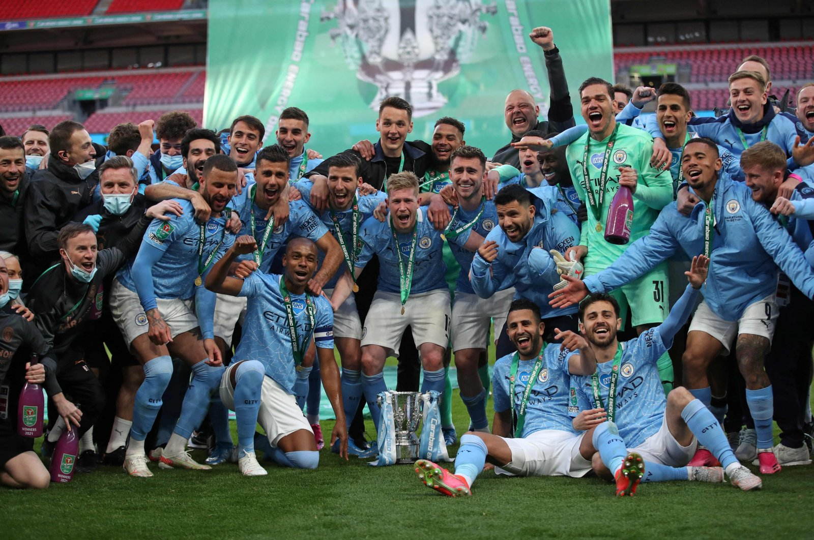 Manchester City players celebrate with the trophy after winning the English League Cup final football match 1-0 against Tottenham Hotspur at Wembley Stadium, northwest London, the U.K., April 25, 2021. (AFP Photo)