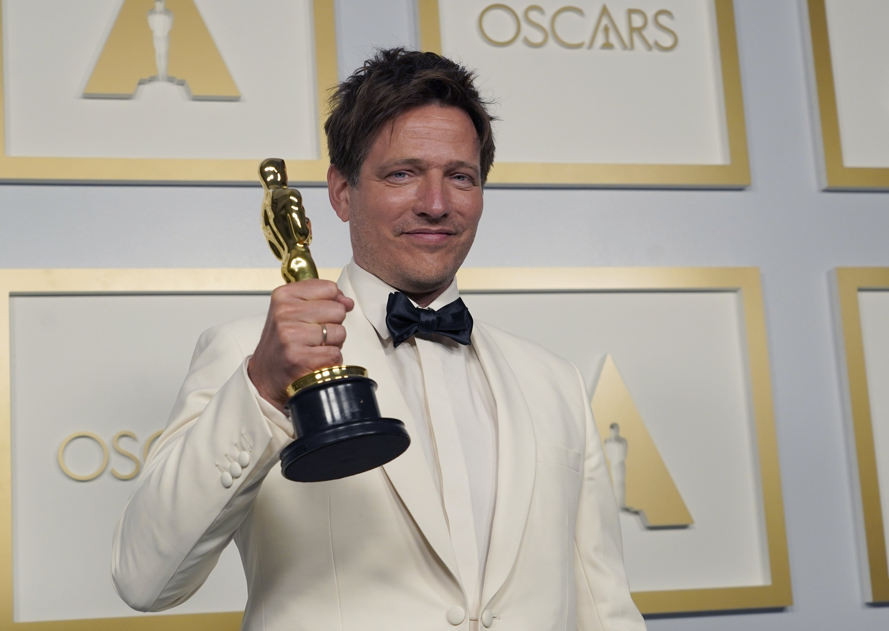 Thomas Vinterberg, from Denmark, poses in the press room with the award for best international feature film for 'Another Round' at the Oscars, at Union Station in Los Angeles, U.S., April 25, 2021. (AP Photo)