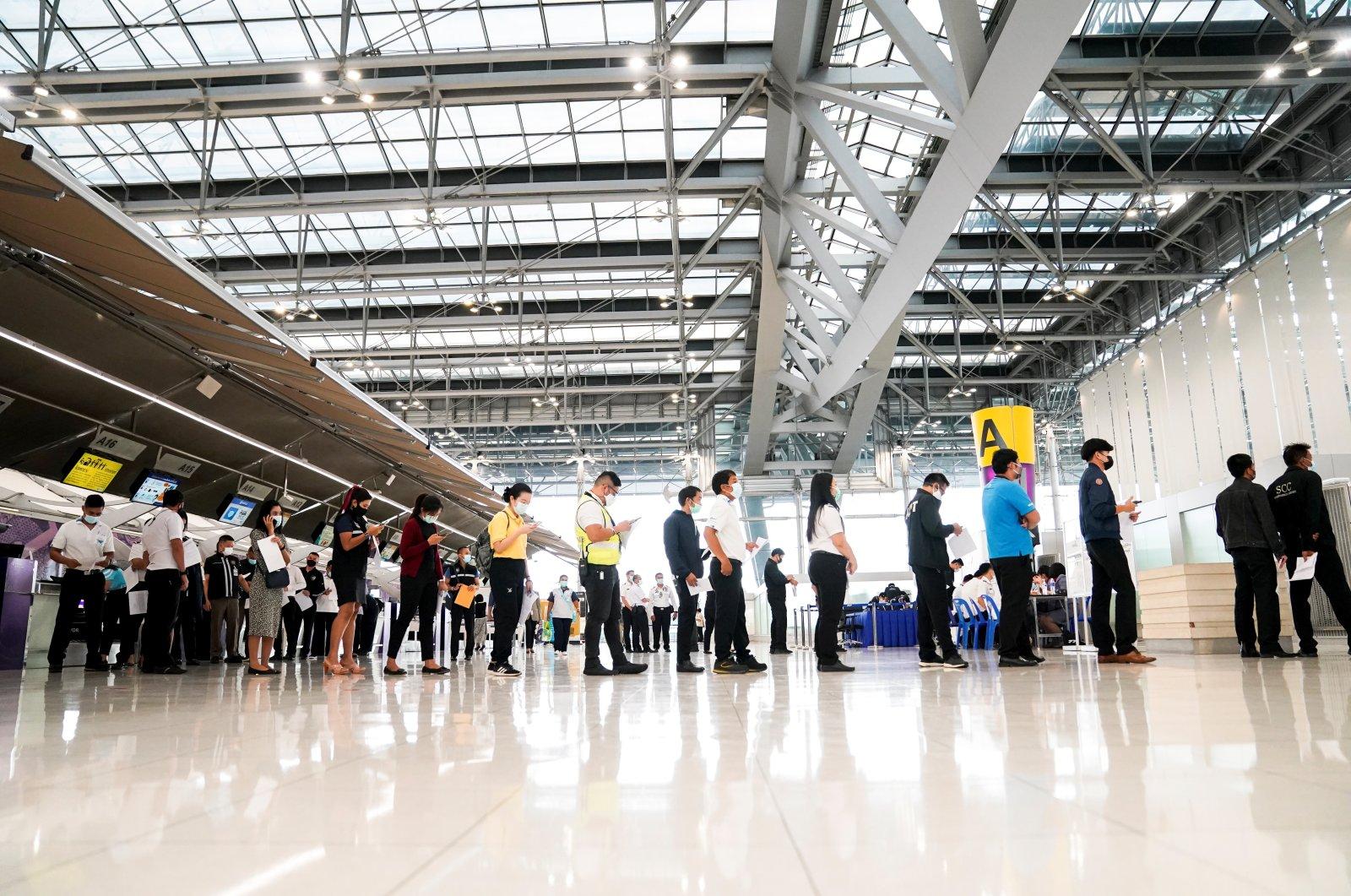 Airport staff line up to receive China's Sinovac COVID-19 vaccine at Suvarnabhumi Airport, Bangkok, Thailand, April 5, 2021. (Reuters Photo)