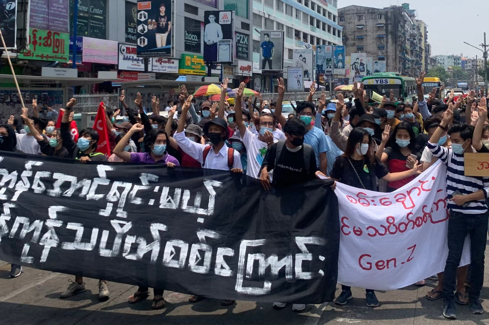 Protesters hold up the three-finger salute as they take part in a demonstration against the military coup in Tarmwe township in Yangon, Myanmar, April 26, 2021. (AFP Photo)