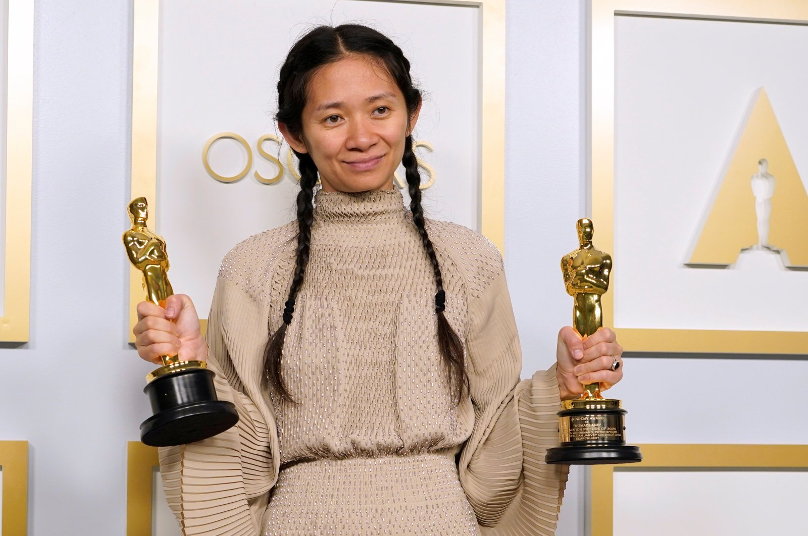 """Chloe Zhao, winner of the award for Best Picture for """"Nomadland,"""" poses in the press room at the Oscars, in Los Angeles, California, U.S., April 25, 2021. (Reuters Photo)"""