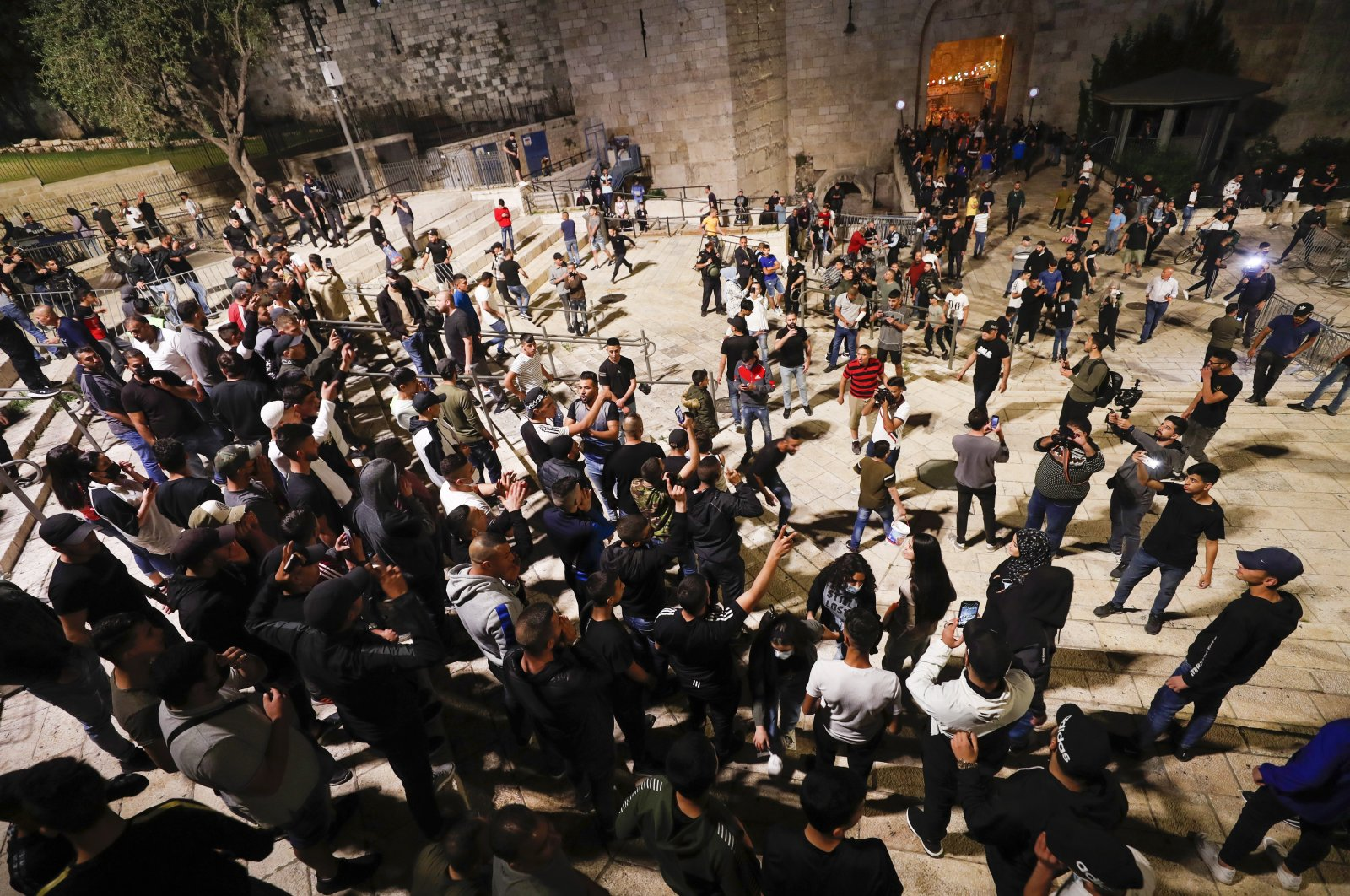 Palestinians celebrate after police removed the barricades blocking access and gatherings around the Damascus Gate area of the Old City in Jerusalem, Israel, April 25, 2021. (EPA Photo)
