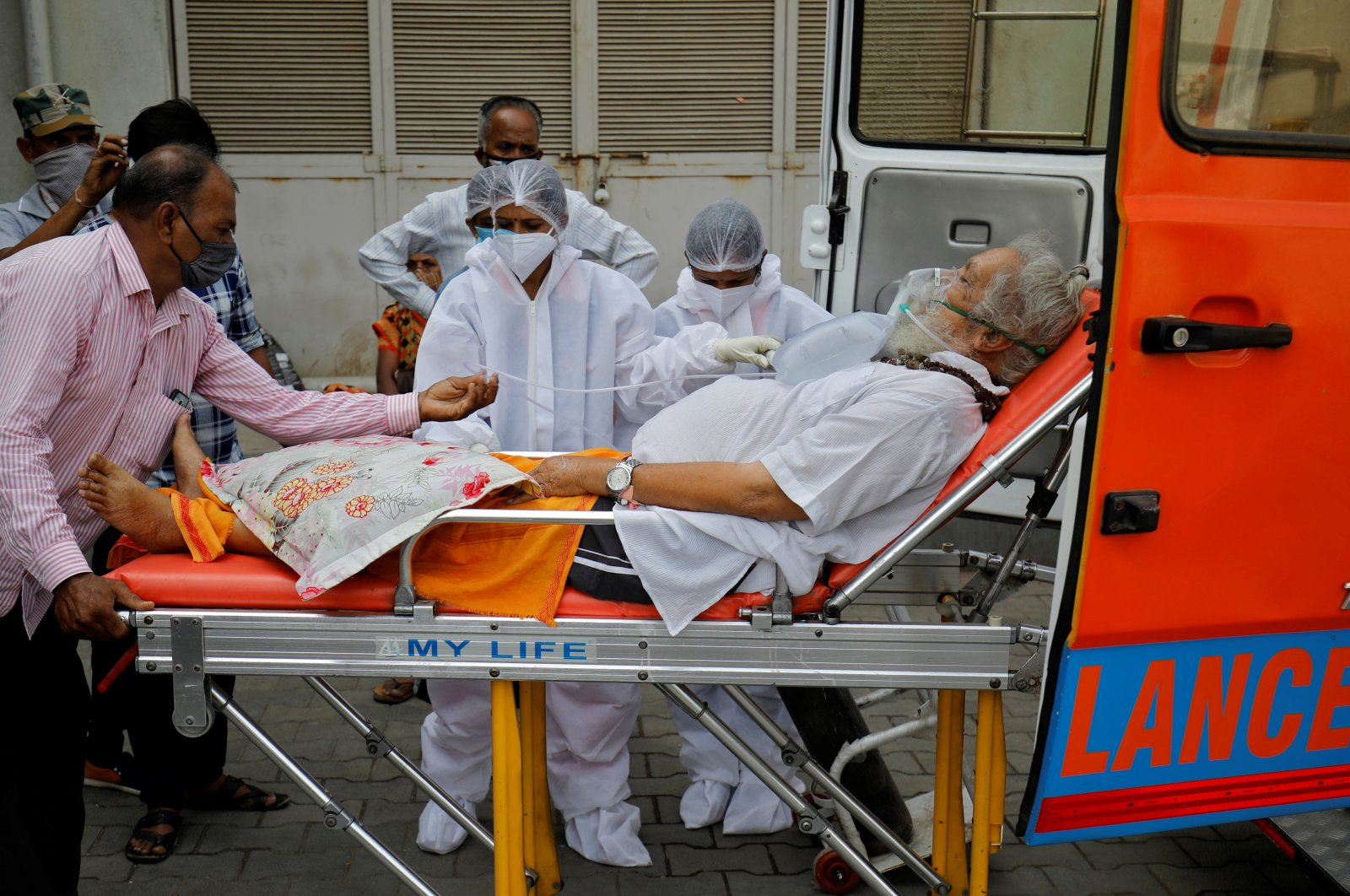 A patient wearing an oxygen mask is wheeled inside a COVID-19 hospital for treatment amid the spread of the coronavirus in Ahmedabad, India, April 26, 2021. (Amit Dave via REUTERS)