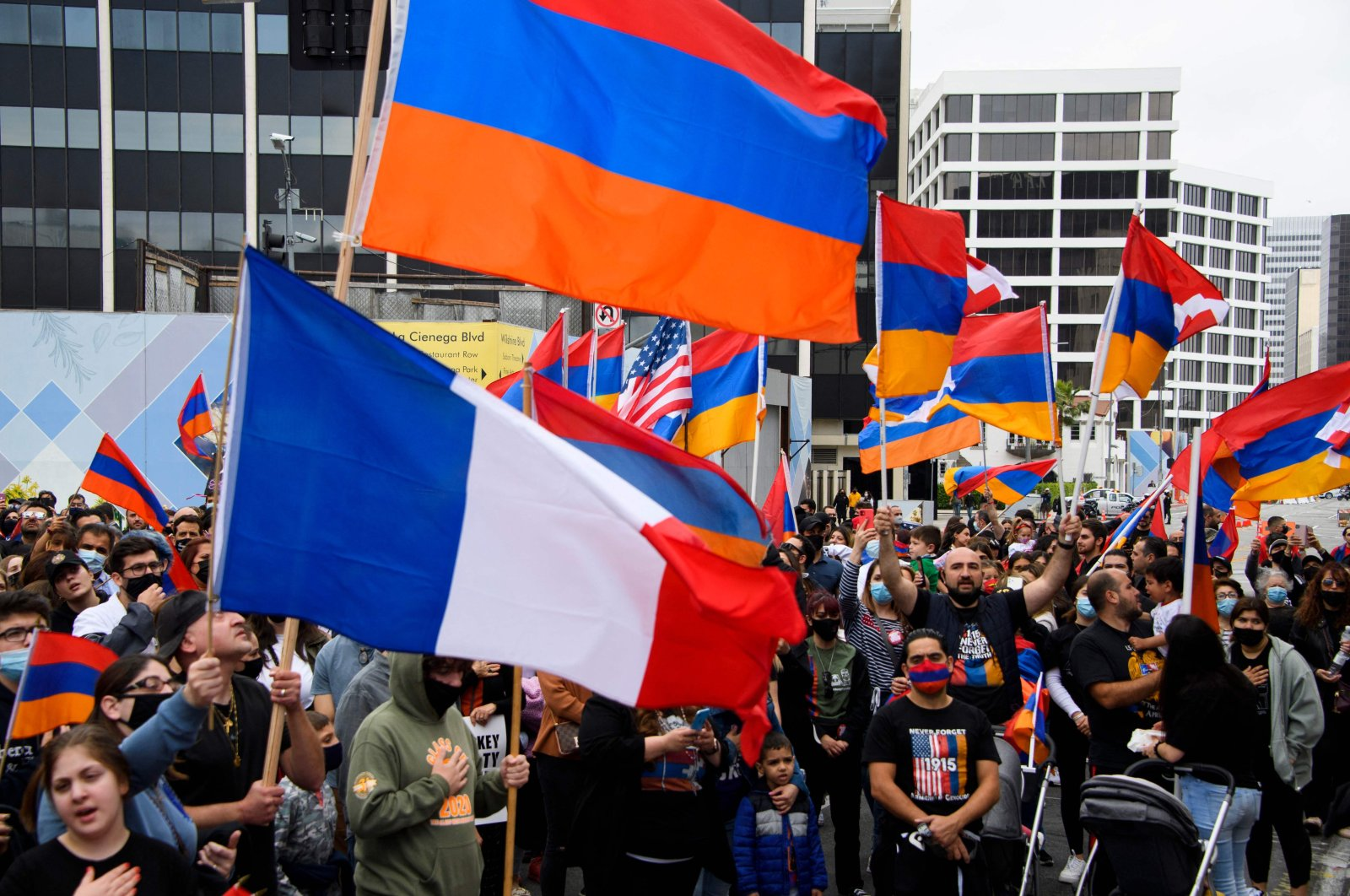 A French flag is waved alongside Armenian flags as people protest outside of the Turkish Consulate on the anniversary of the 1915 events in a demonstration organized by the Armenian Youth Federation (AYF) in Beverly Hills, California, U.S., April 24, 2021. (AFP Photo)