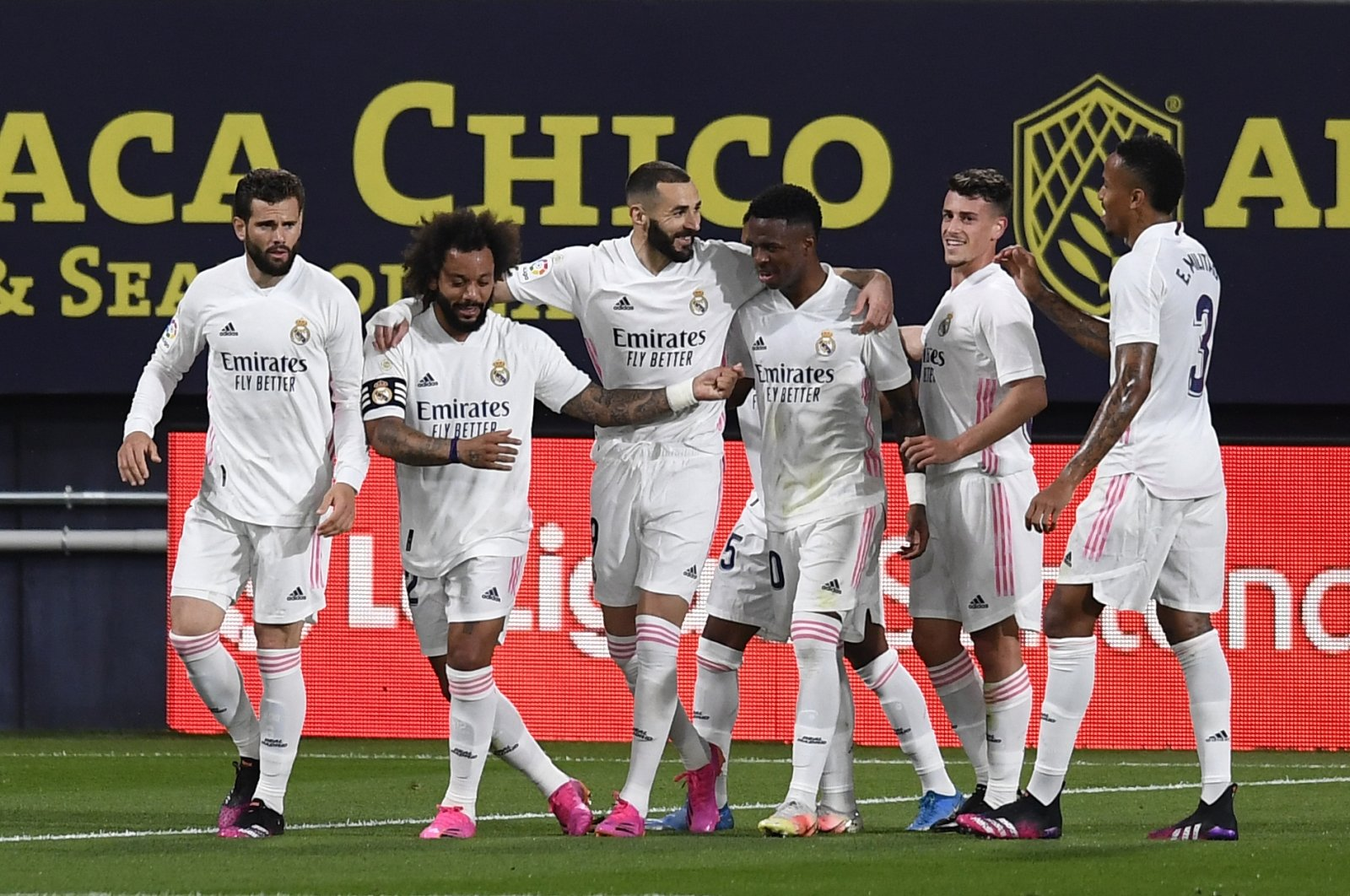 Real Madrid's players celebrate a goal during a La Liga match against Cadiz at the Ramon Carranza stadium in Cadiz, Spain, April 21, 2021. (AP Photo)