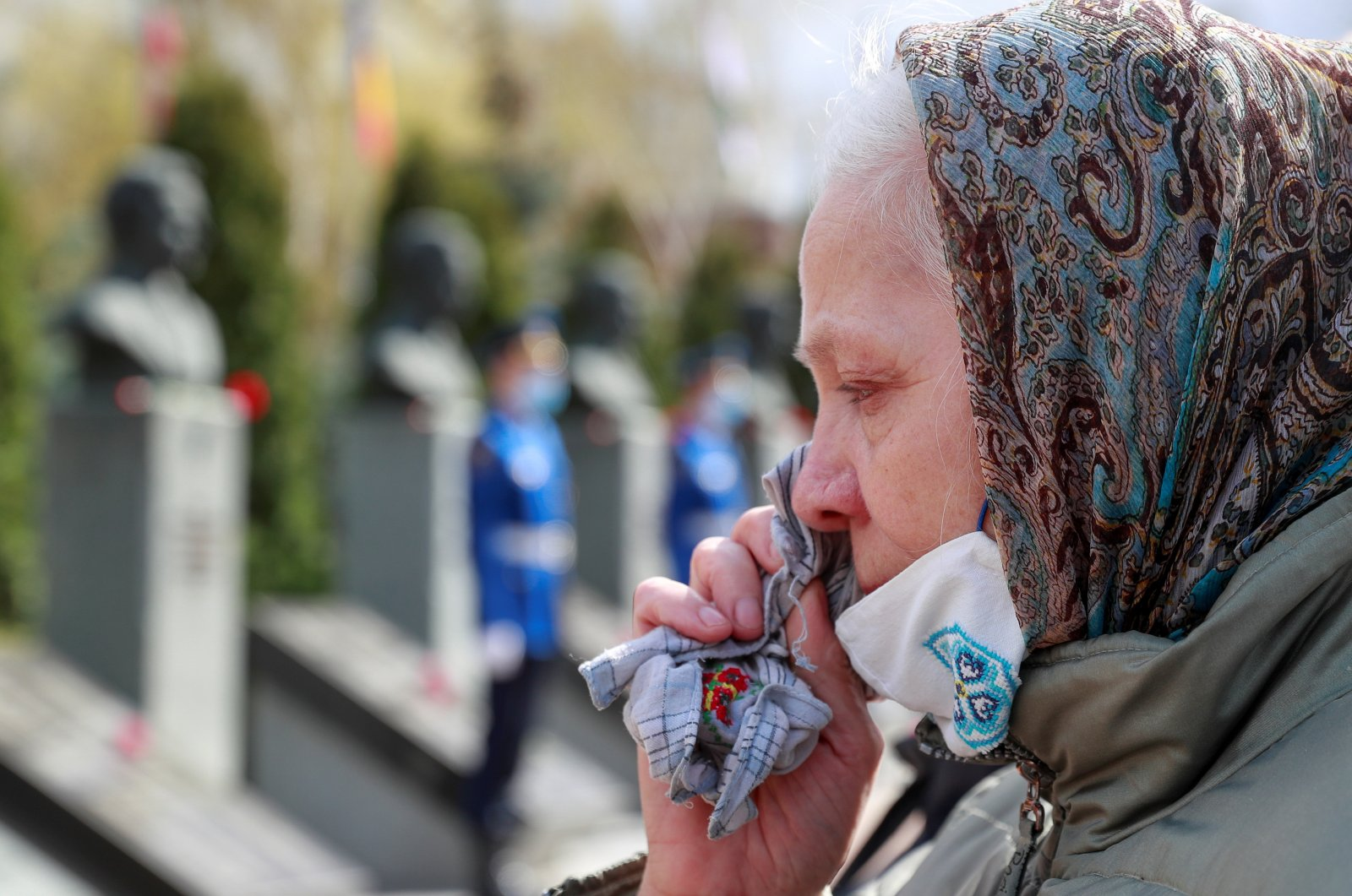 A woman sheds a tear during a commemoration ceremony marking the 35th anniversary of the Chernobyl disaster at a memorial to firefighters and workers, who died following the explosion of a reactor at the Chernobyl Nuclear Power Plant, in Kyiv, Ukraine, April 26, 2021. (Reuters Photo)