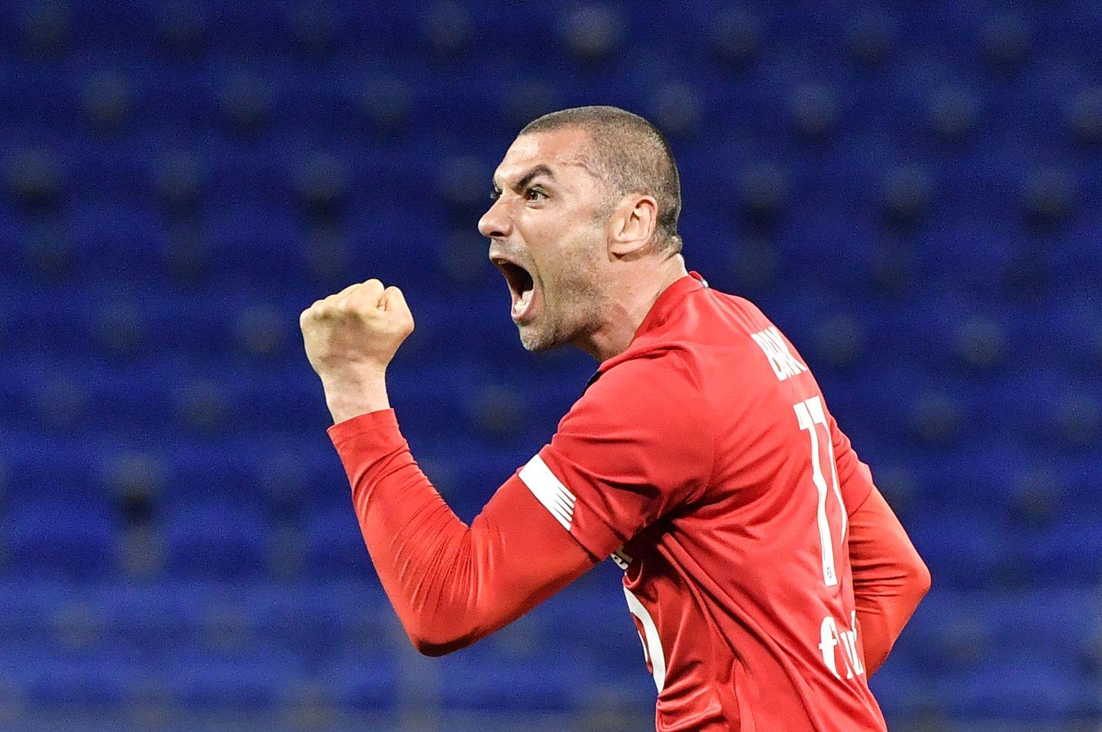 Lille's Turkish forward Burak Yılmaz reacts after scoring during the Ligue 1 football match against Lyon at the Groupama Stadium in Decines-Charpieu near Lyon, France, April 25, 2021. (AFP Photo)
