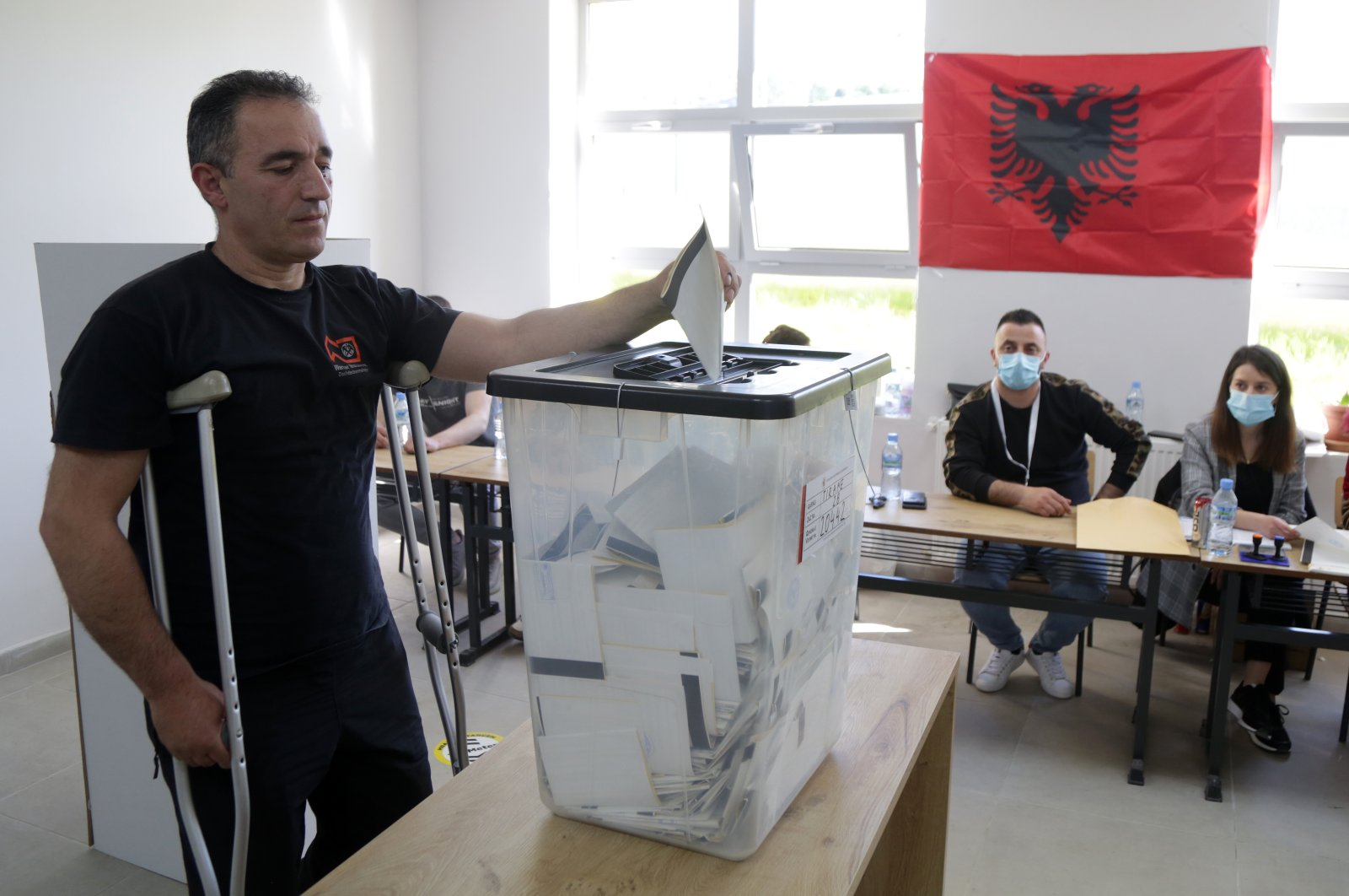 Albanian citizens cast their votes at a polling station in Tirana, Albania, April 25, 2021. (EPA Photo)