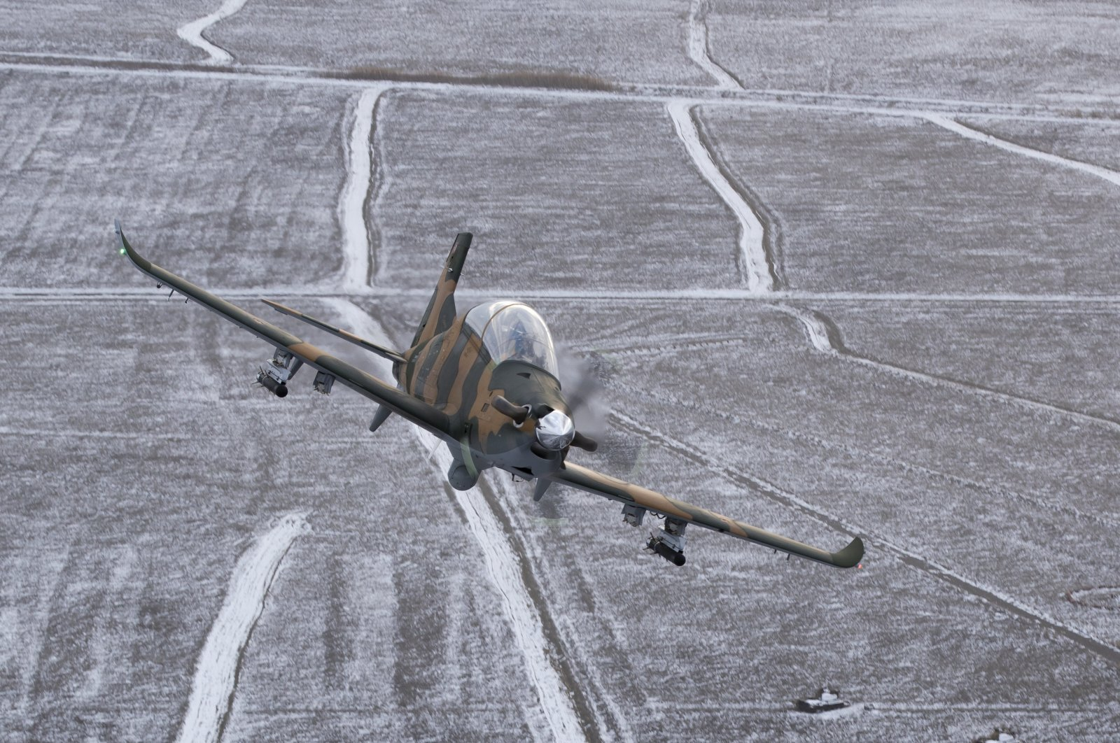 TAI's Hürkuş-C aircraft is pictured mid-flight in this file photo from Dec. 31, 2018. (Courtesy of the Presidency of Defense Industries)